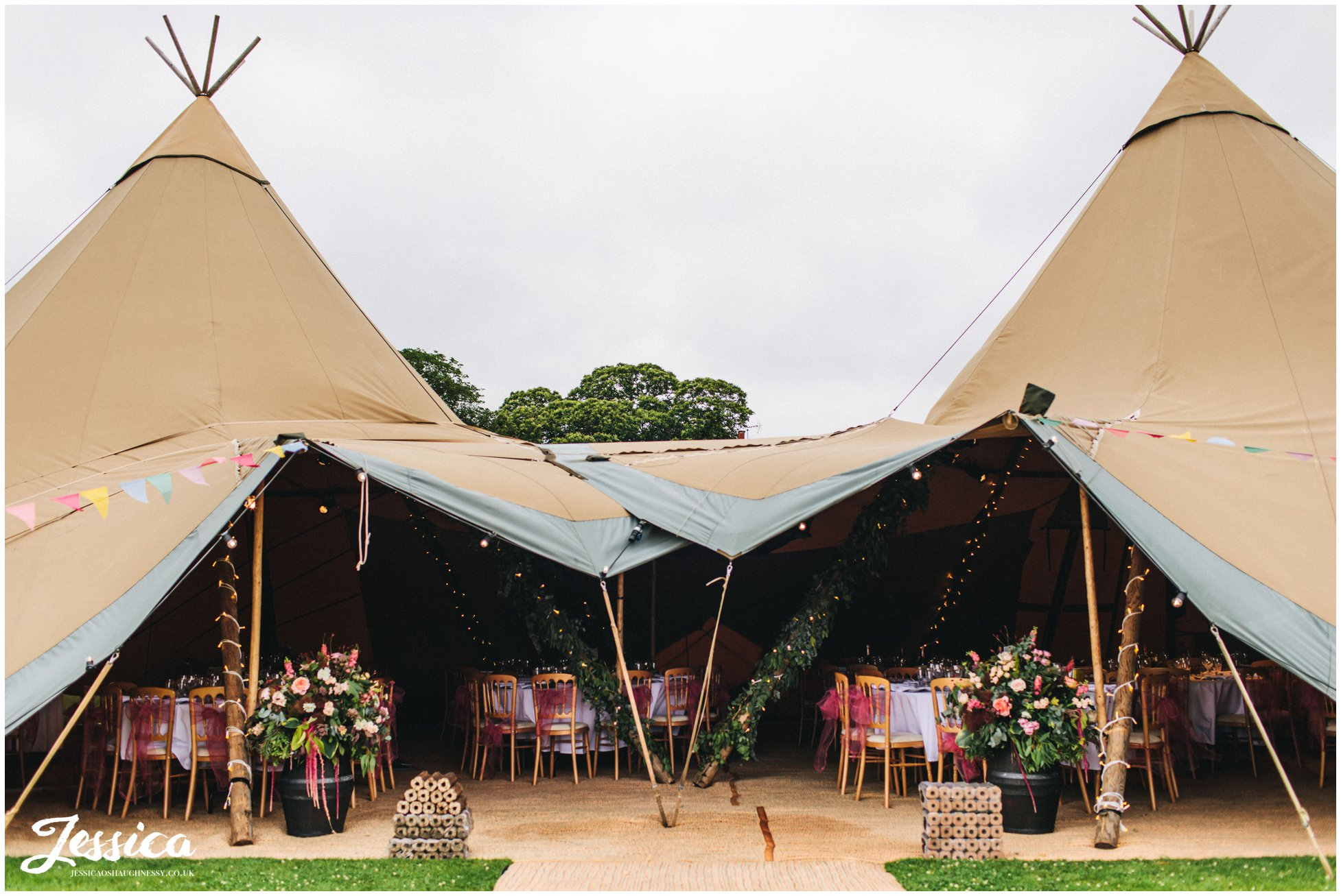 the tipi decorated in bright colours & flowers