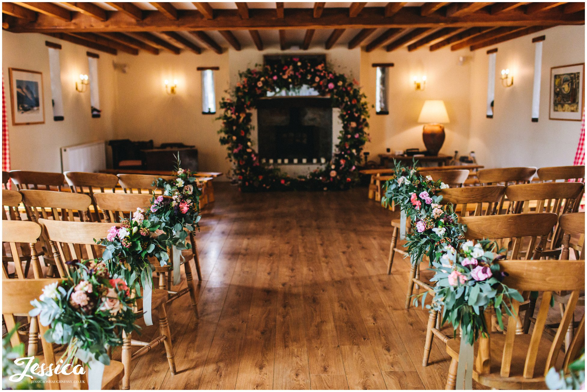 the ceremony room at the outbuildings is decorated in flowers