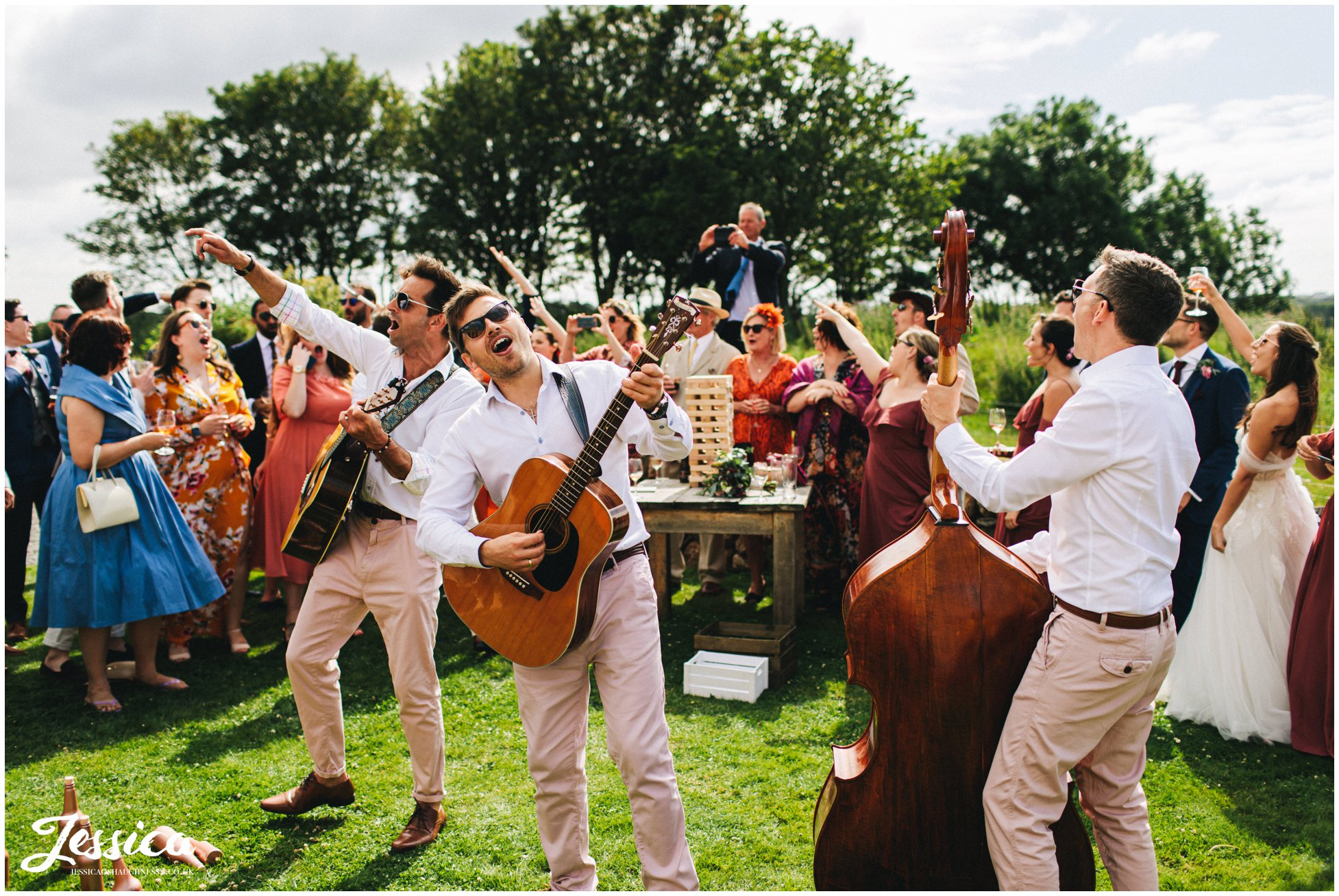 wedding band plays to the guests outside the tipi