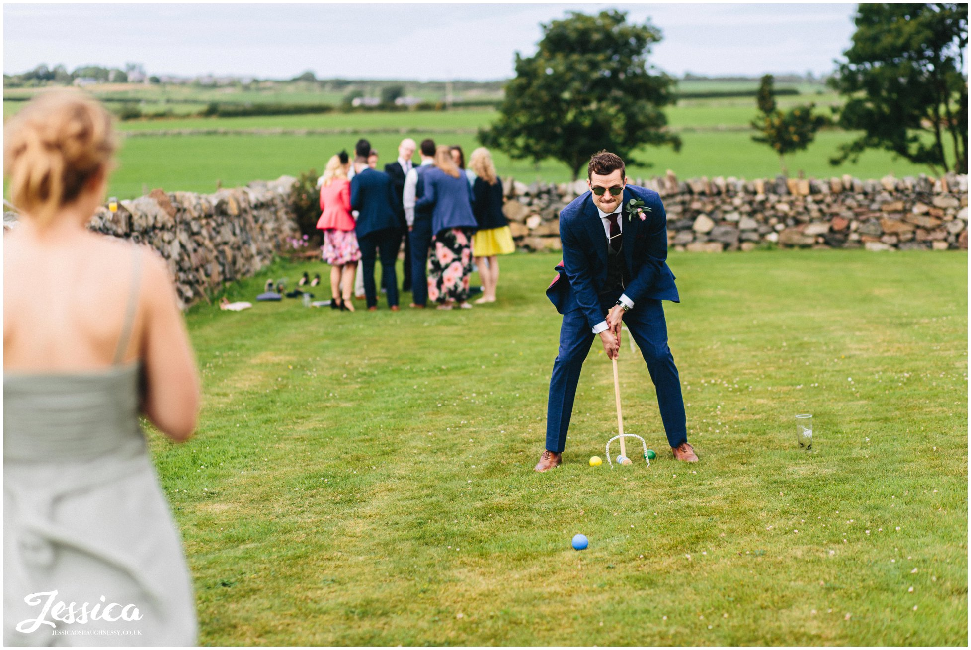 groom plays croquet at his north wales tipi wedding