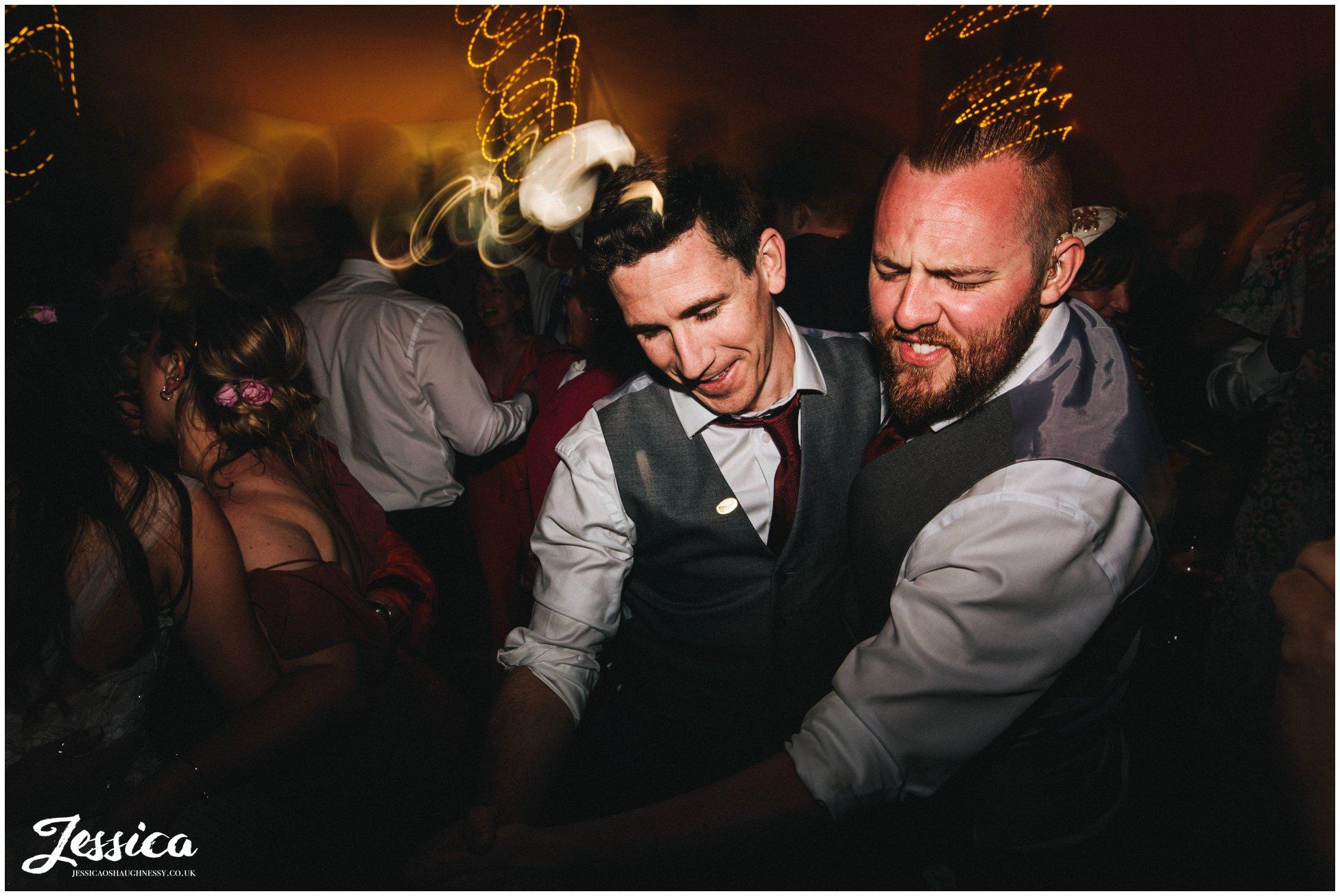 groomsmen dance together at the tipi wedding