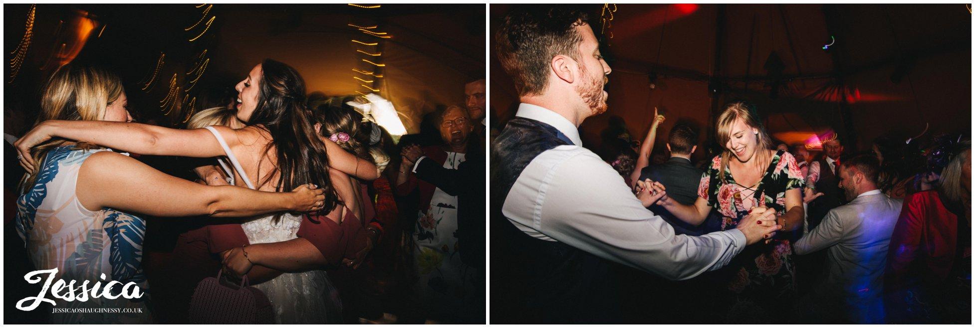 guests enjoy the dancefloor at the north wales wedding