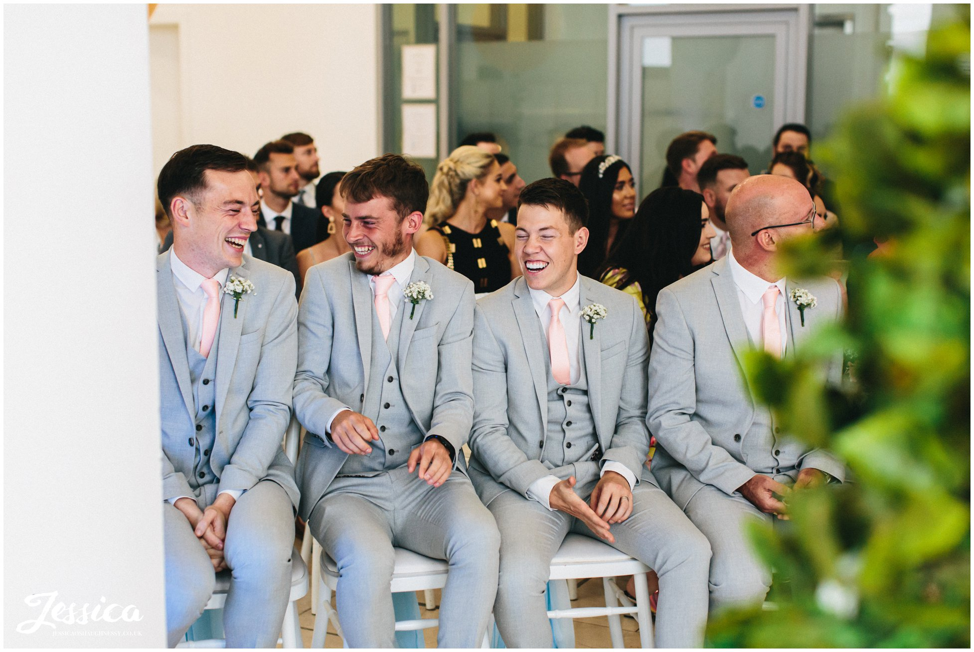 the groomsmen laugh before the liverpool wedding ceremony