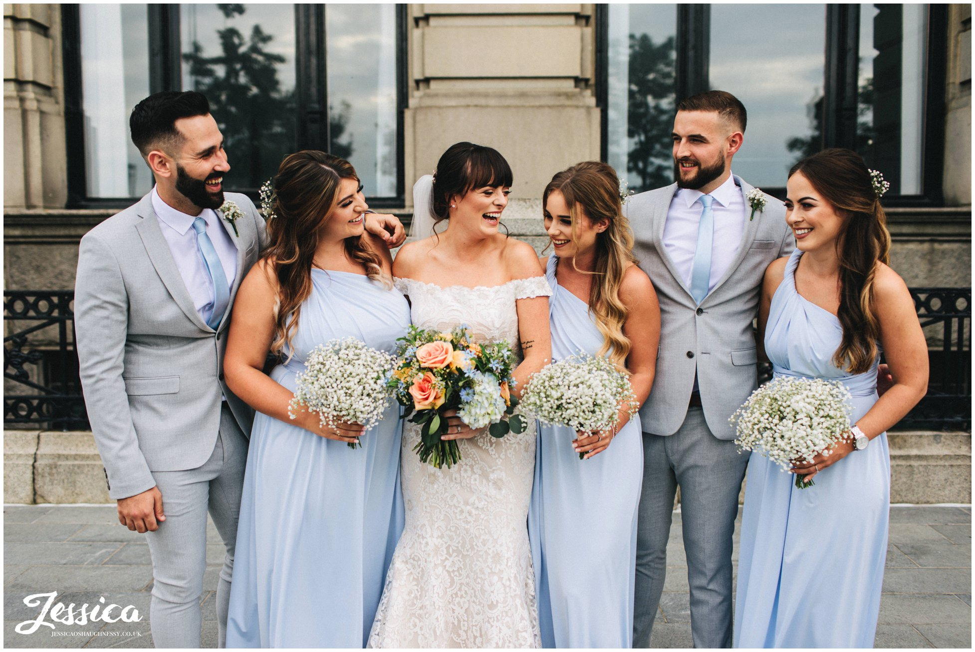 bride laughs with her bridal party