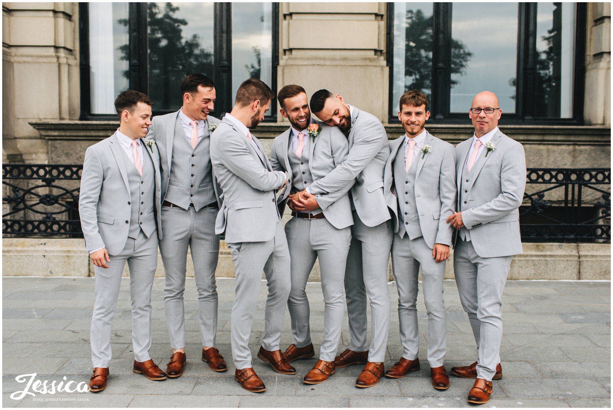 groom & groomsmen joke around outside the liver building