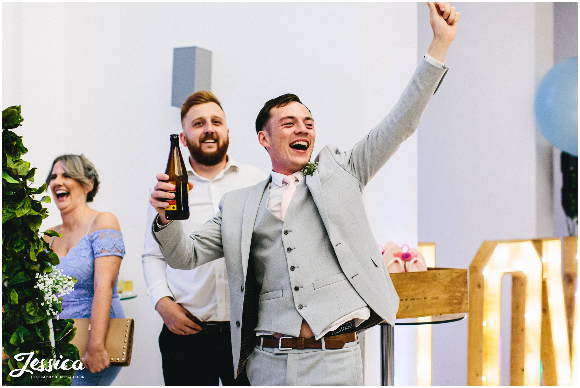 groomsmen cheers as football song is played