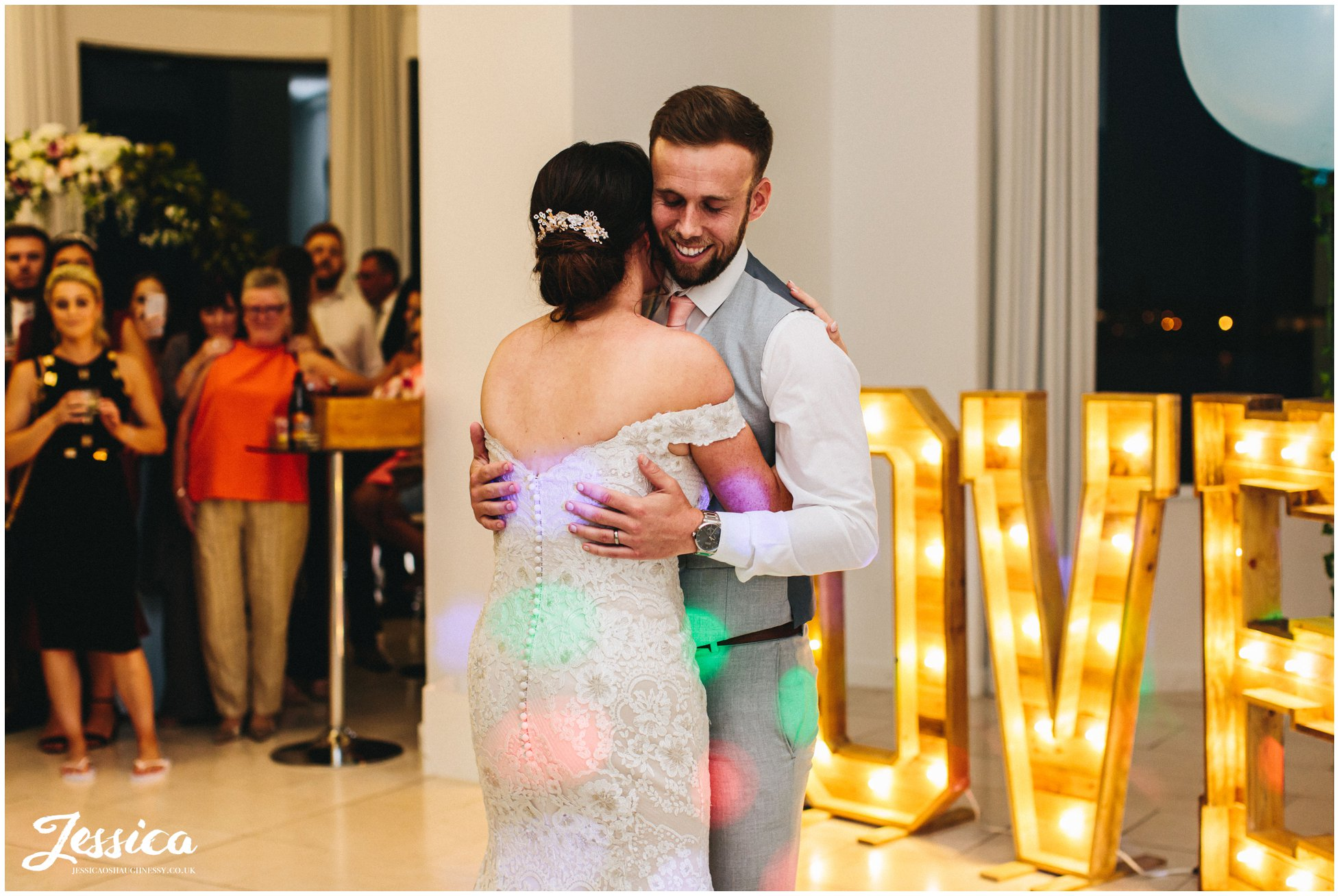 couple share their first dance together