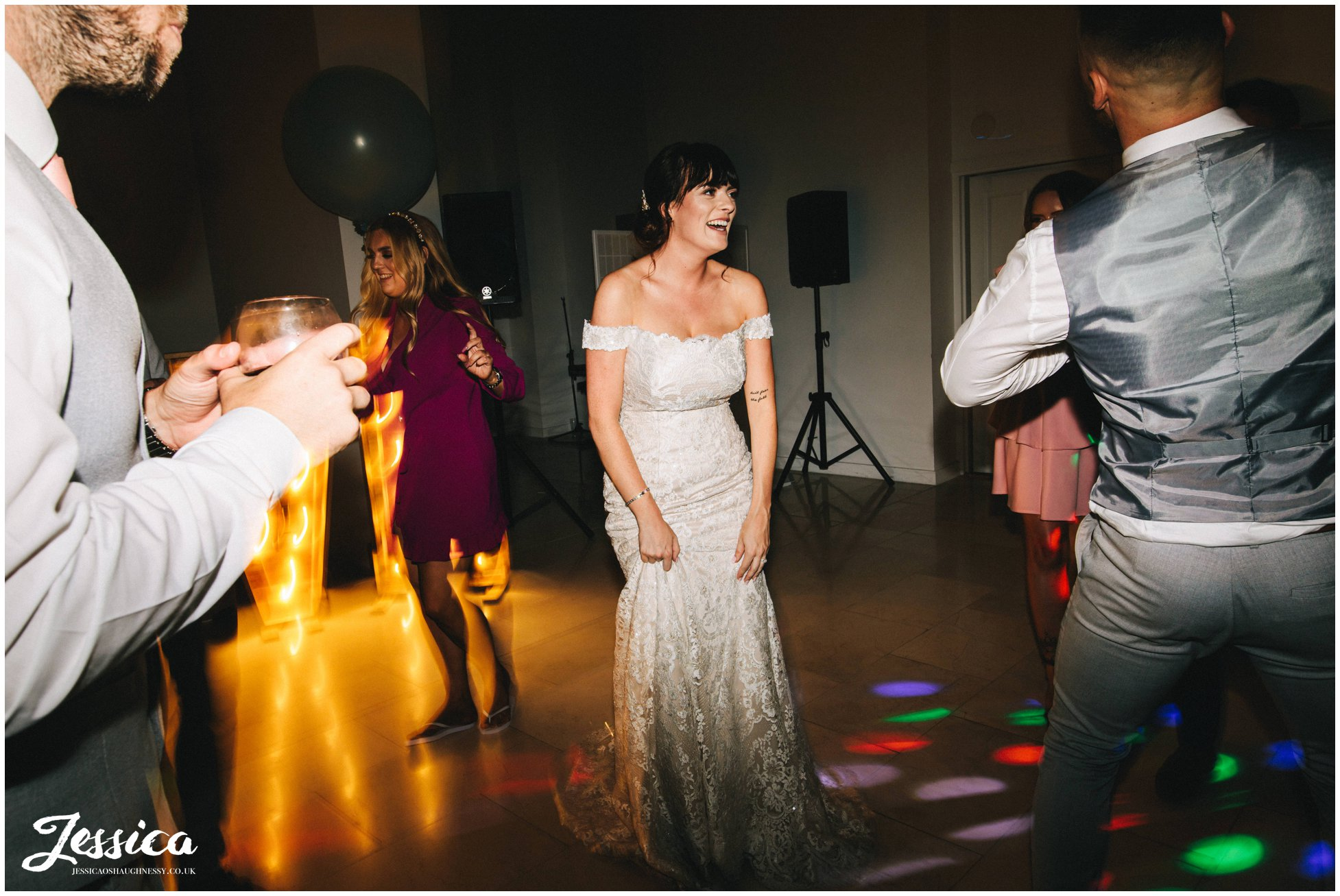 bride dances as the dj starts to play