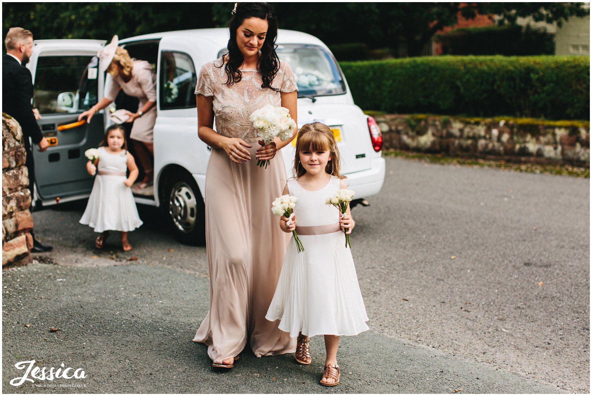 bridesmaids & flower girls arrive at eccleston church