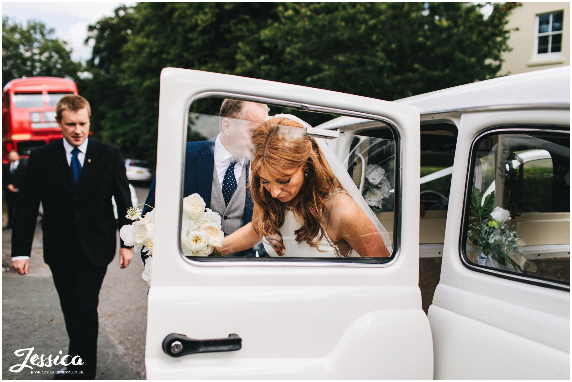 the bride arrives in a white taxi at eccleston church