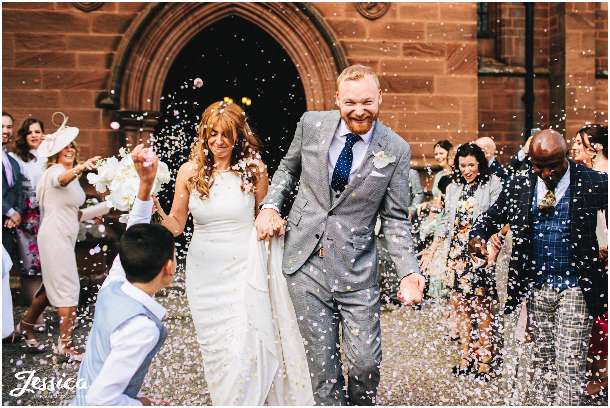 bride & groom walk through a confetti line