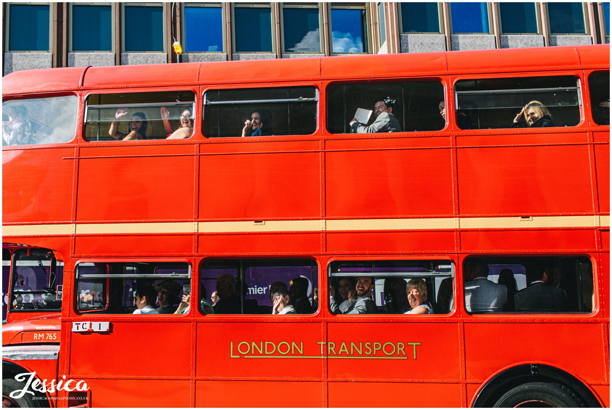red bus pulls up with the wedding guests