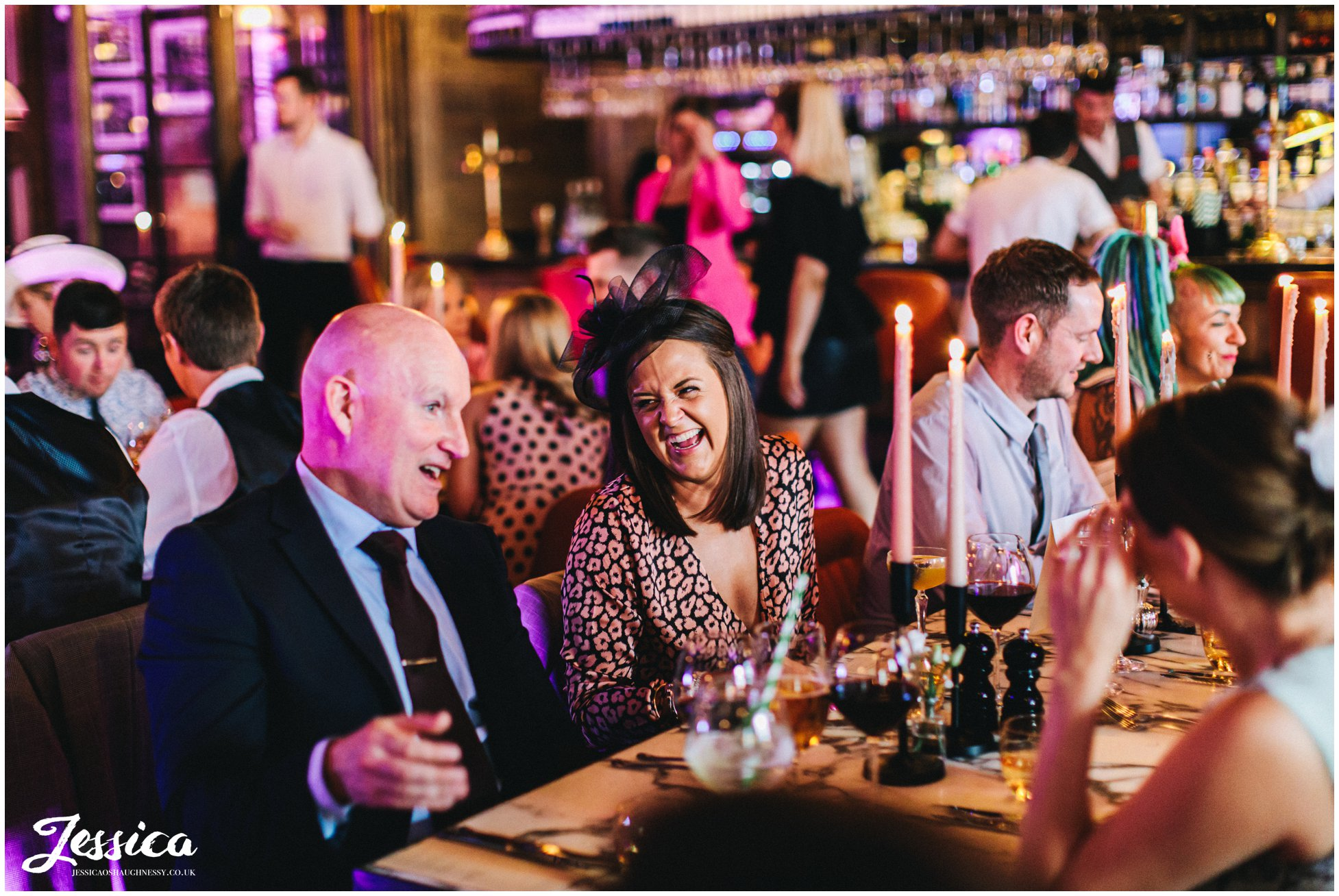guests laugh at opera grill wedding reception in chester