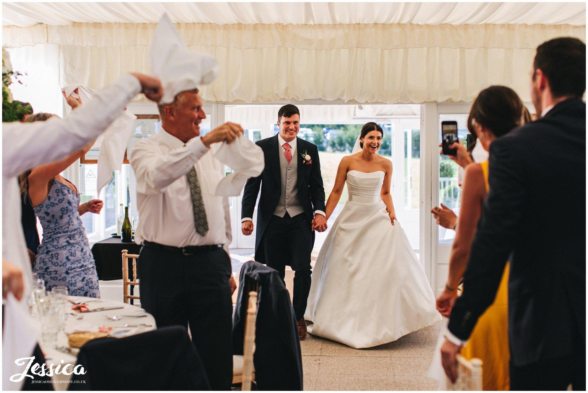 bride & groom enter room for the wedding breakfast
