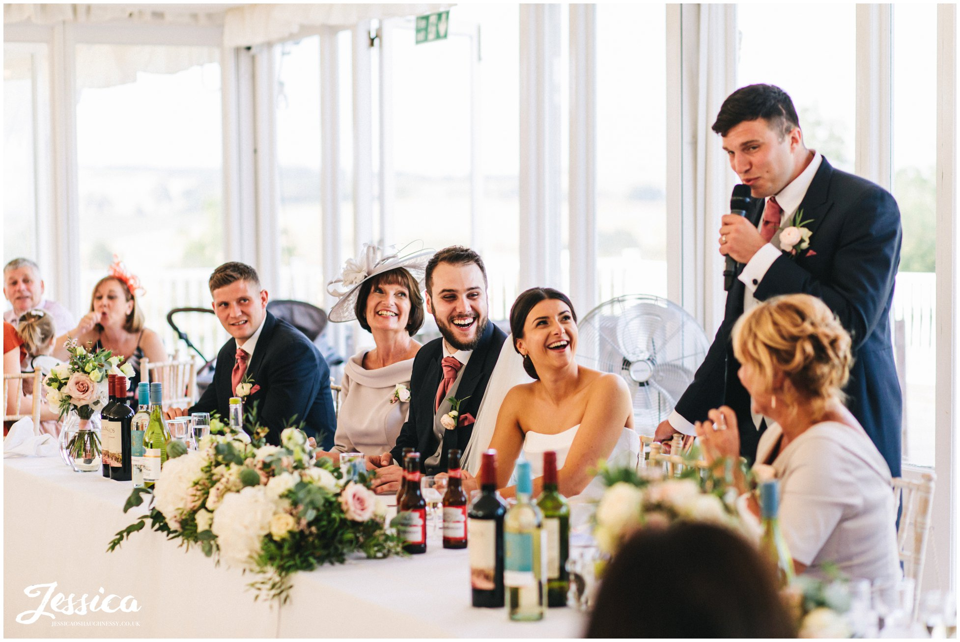 groom makes top table laugh during his speech