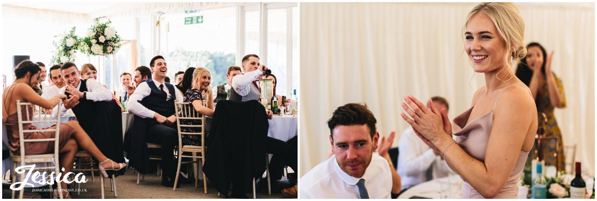 bridesmaid applauds the grooms speech at keythorpe manor