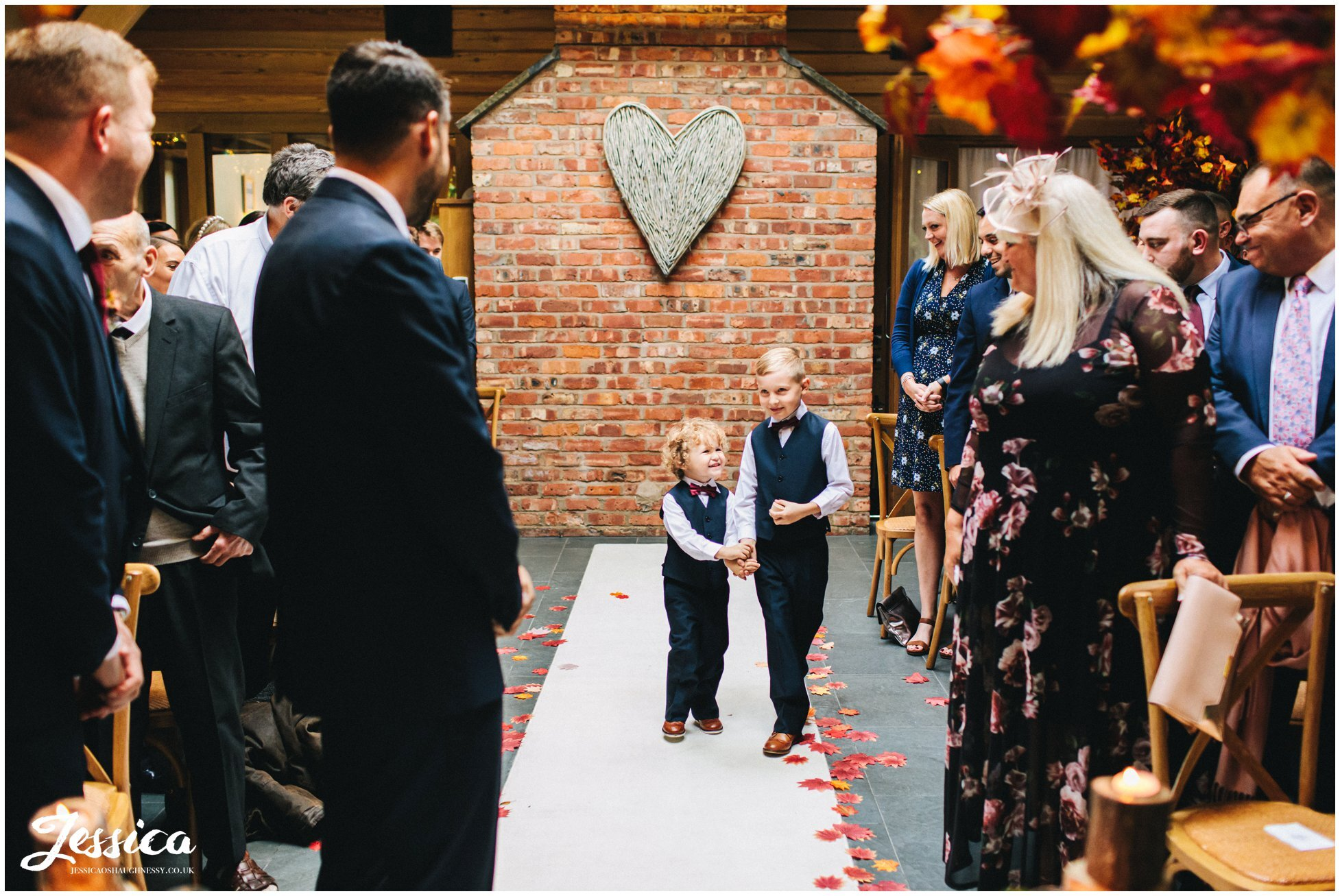 page boys walk down the autumnal aisle