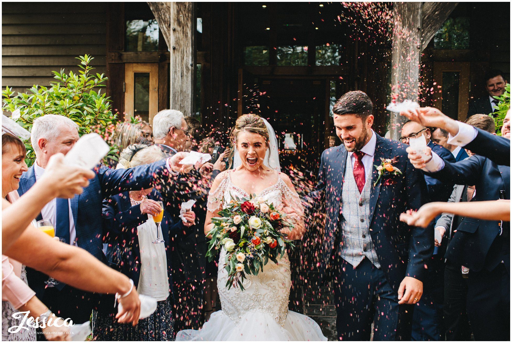 couple get showered in confetti outside the oak tree of peover