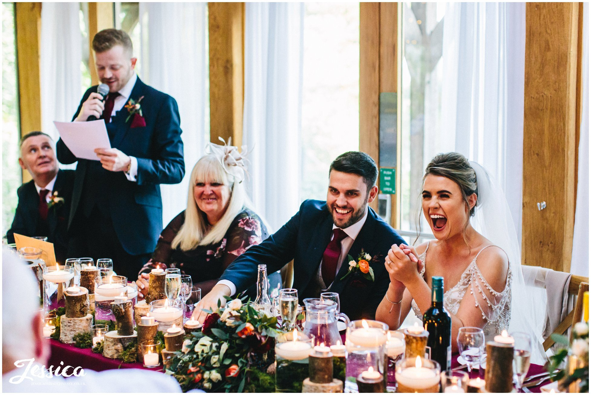 top table laugh during the best man speech