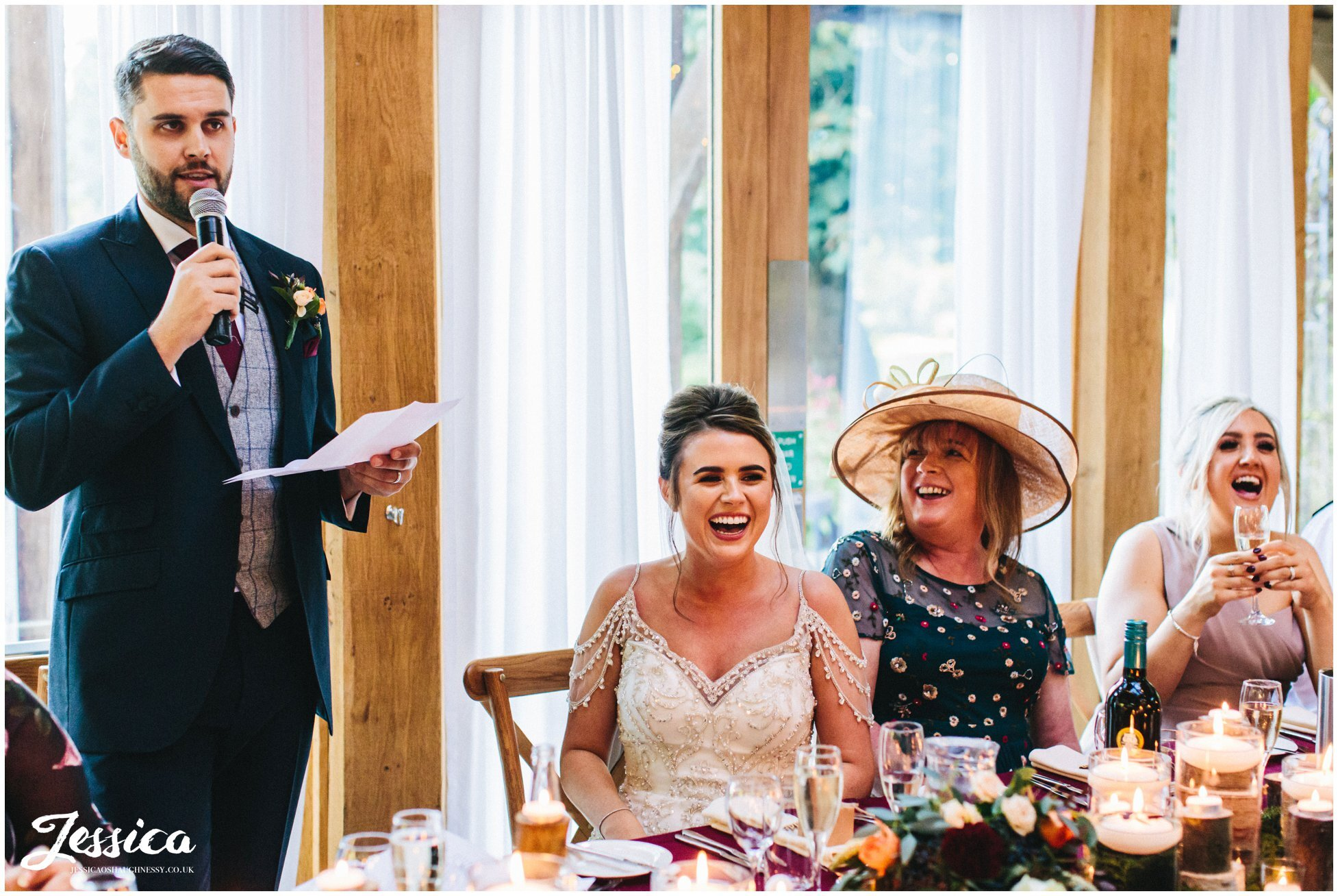 groom stands to give his speech at the cheshire wedding