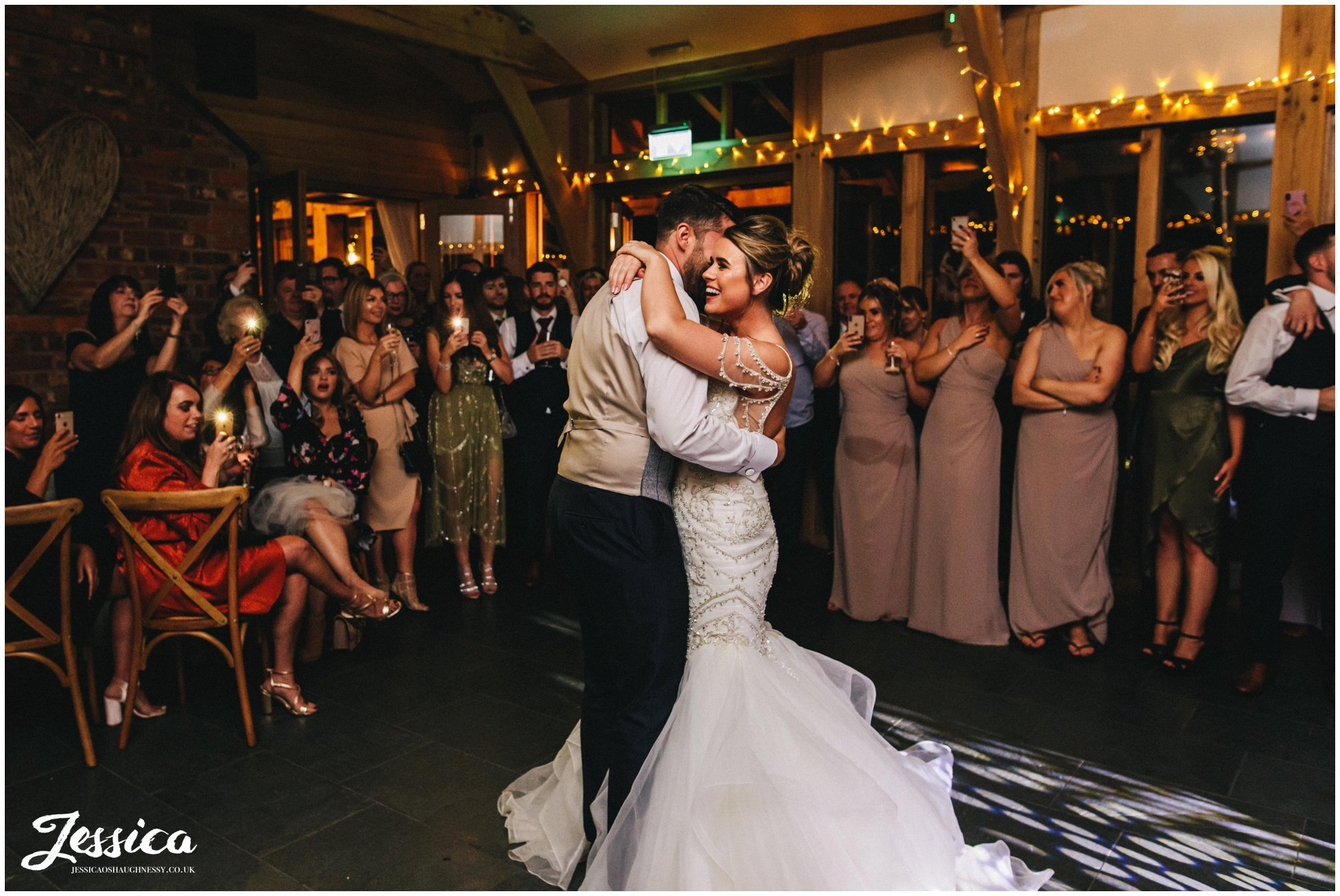 the couple share their first dance together