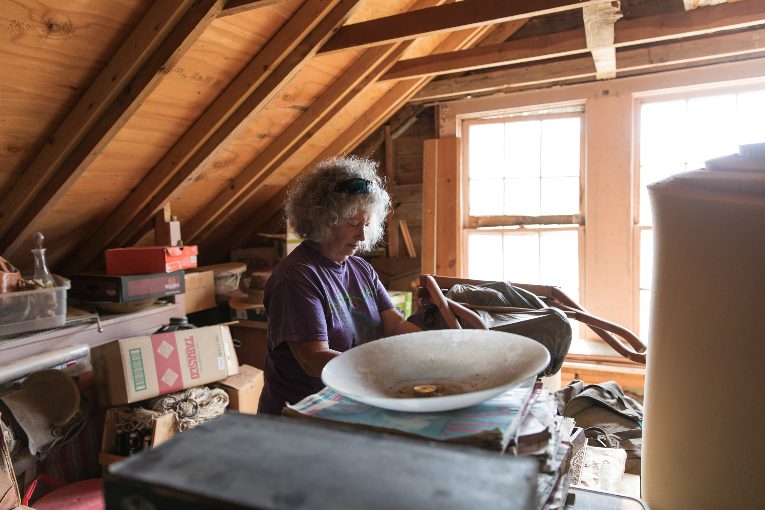 Zita Coombs, Grand-daughter to Great Grandma Zita, digging through items in the ranch headquarters.
