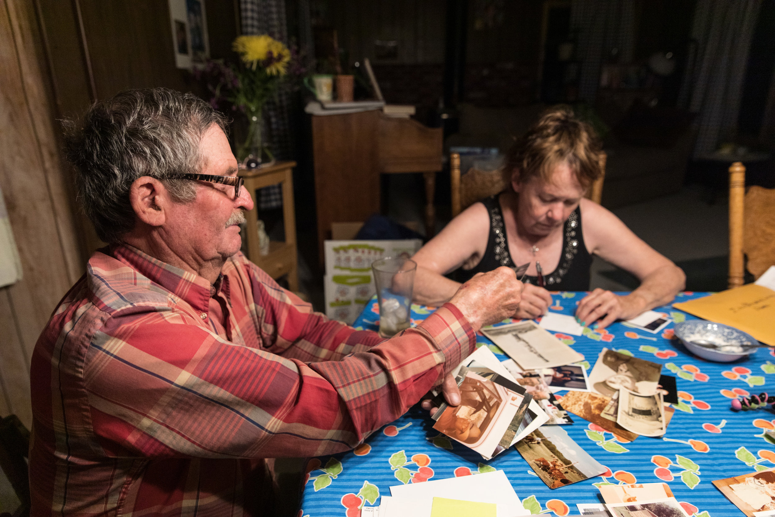 My parents, Larry, grandson of Great Grandma Zita, and Nora Gilstrap going through old photographs.