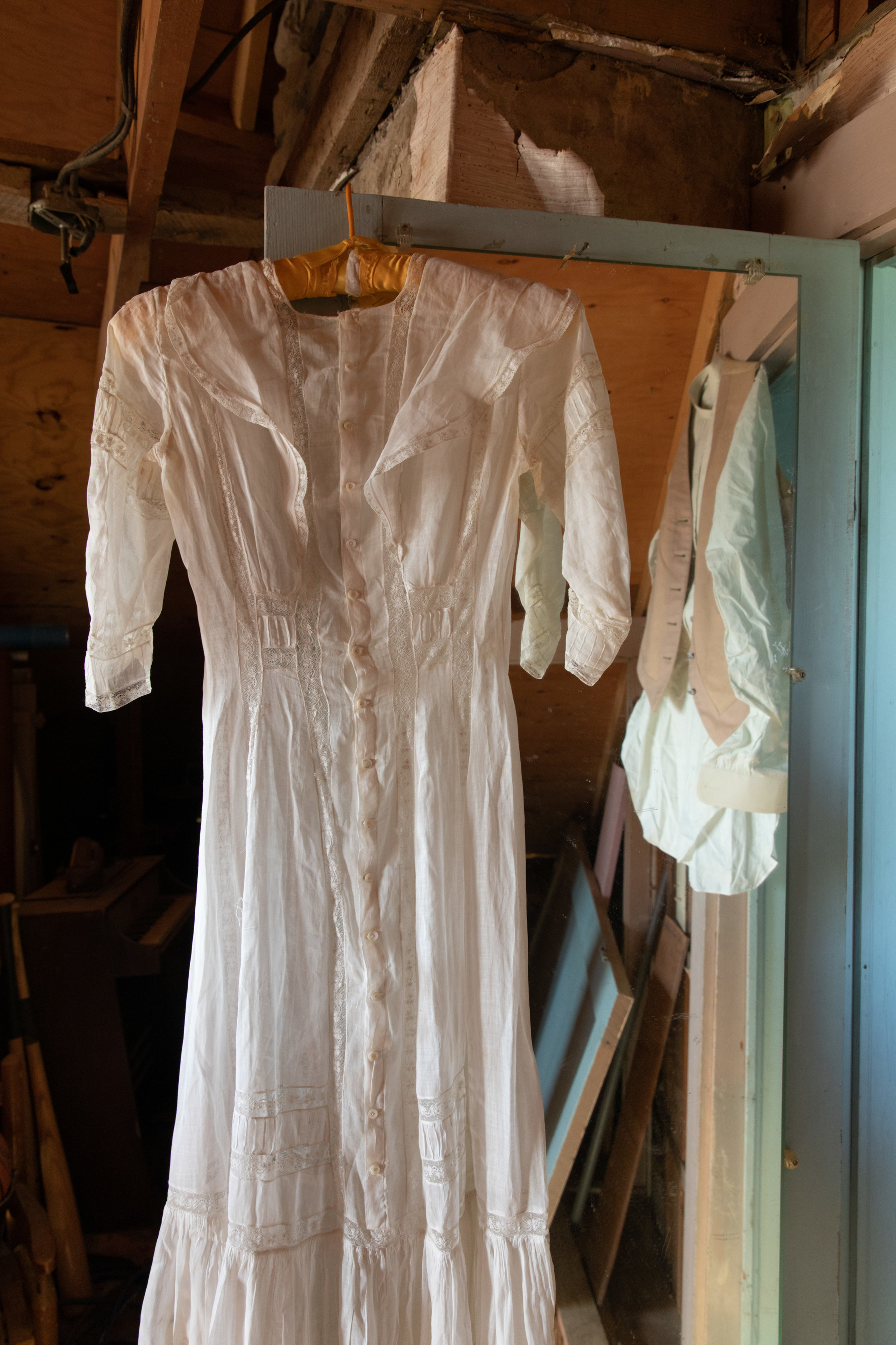 A dress and shirt in vest found among Great Grandma's belongings.