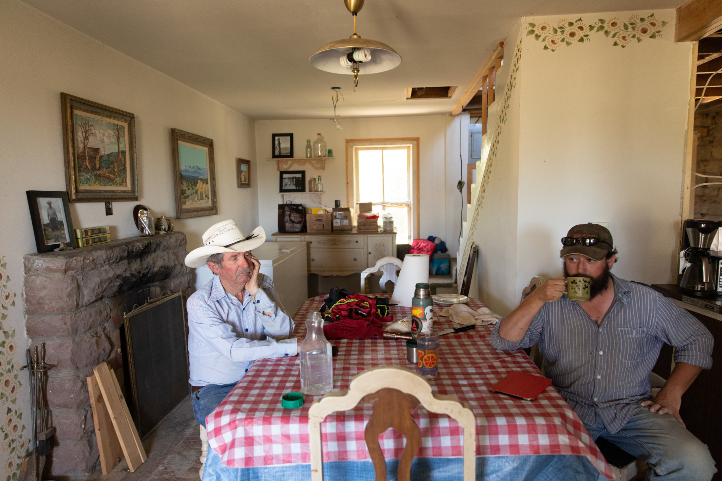 Larry and Ben Gilstrap during a conversation about water on the ranch.  Over the years water has become more and more of an issue.  This conversation took place in the ranch headquarters, my great grandparent's home, which my brother is remodeling.