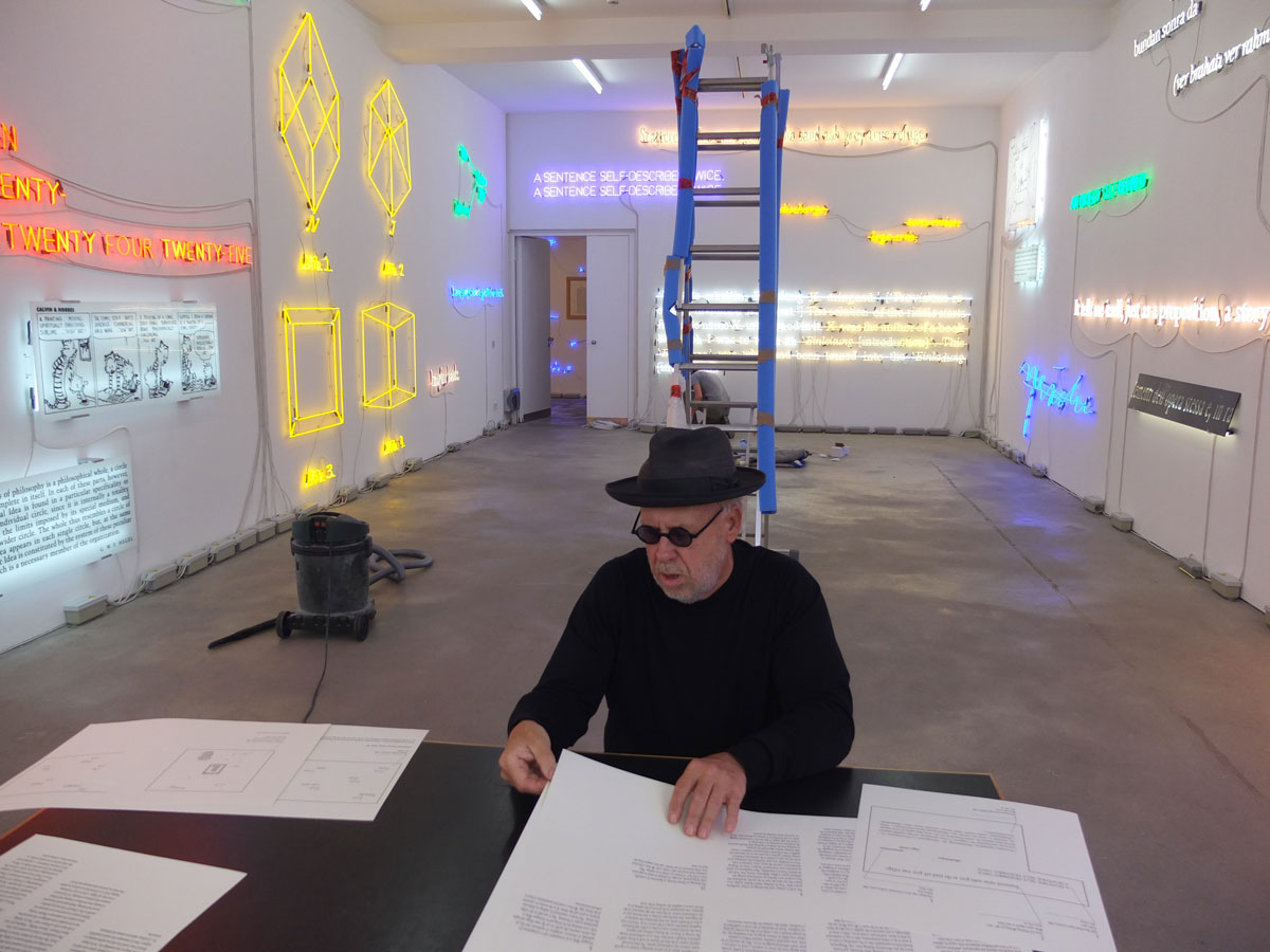 Joseph Kosuth during installation at Sprüth Magers gallery, Berlin. April 2013.    sourced from ( http://www.neonlauro.it/page/3/)