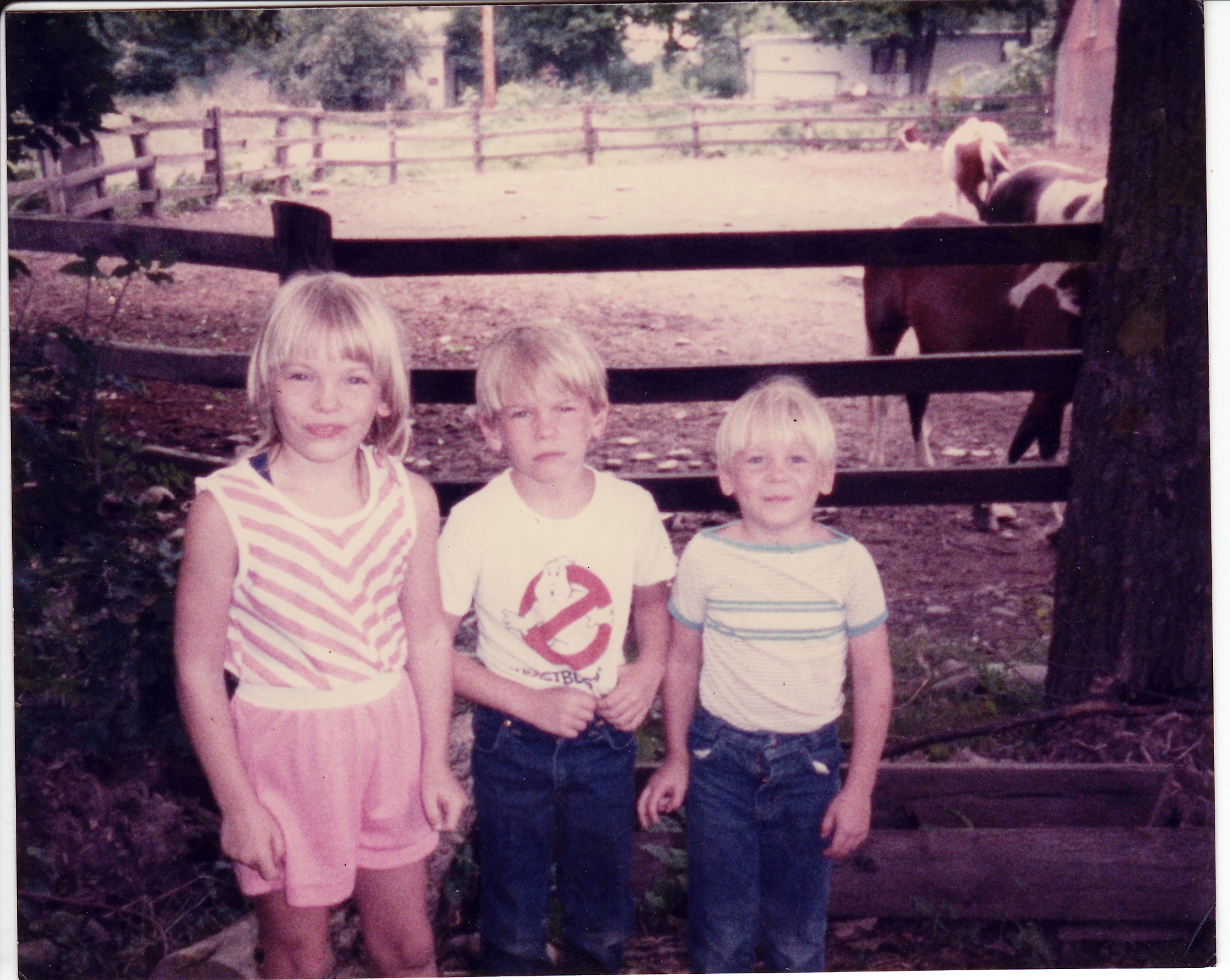 Kim with her brothers and some horses.