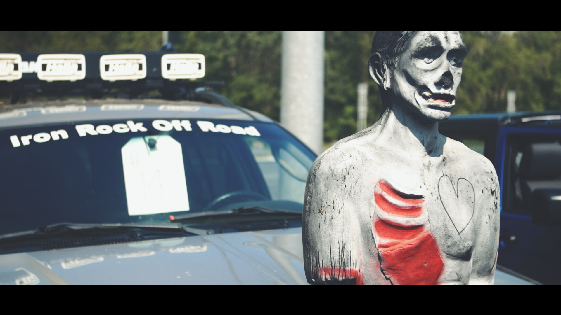 I wish this fake zombie hood ornament looked more like a decomposing Nicolas Cage.