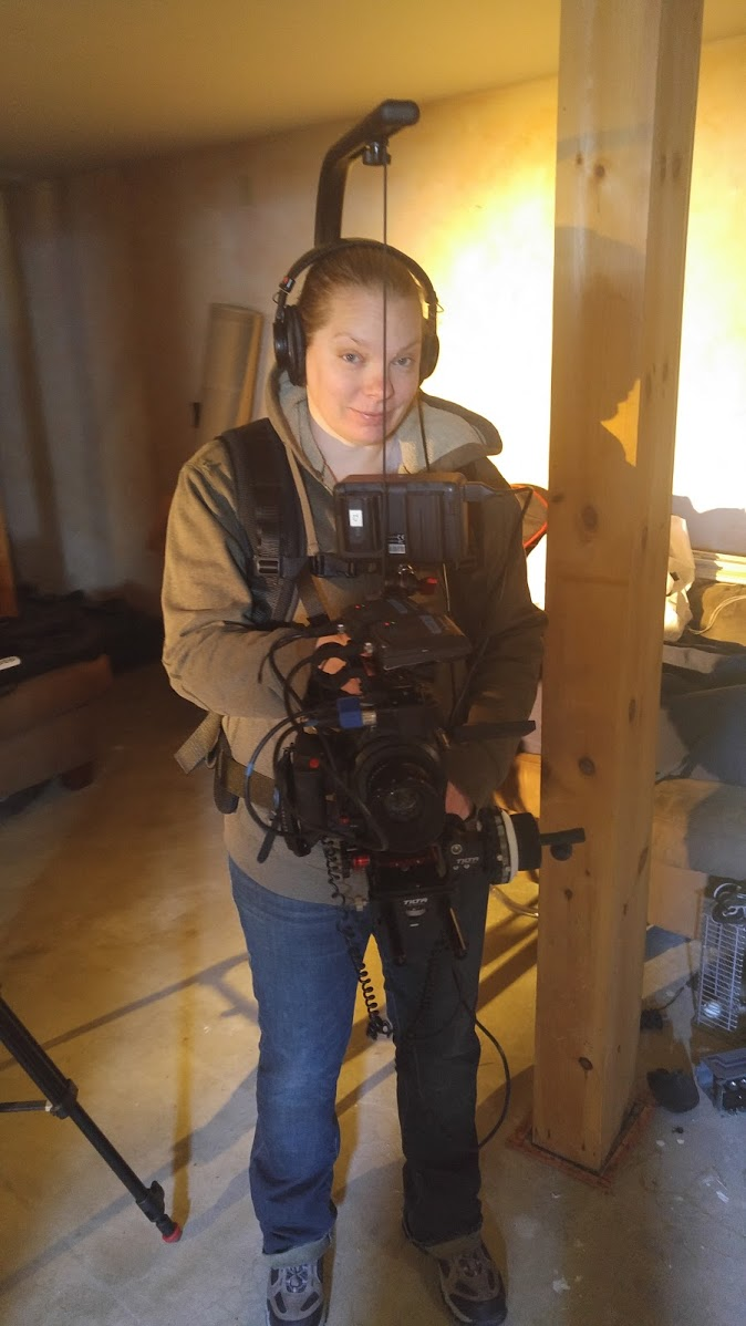 My wife steps behind the camera on our last shoot while I stepped in front of it. Here she is wearing the Easyrig with the C100 Mark II rigged out.