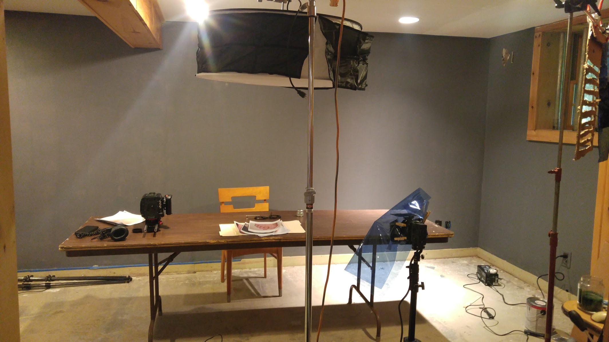 The whole setup - top light in place with a C-Stand, fog machine on ground, window blind pattern on a stand and just off camera a 1K fresnel going through the pattern. There's a small gelled Pro light that we used only for the product close-up shot.