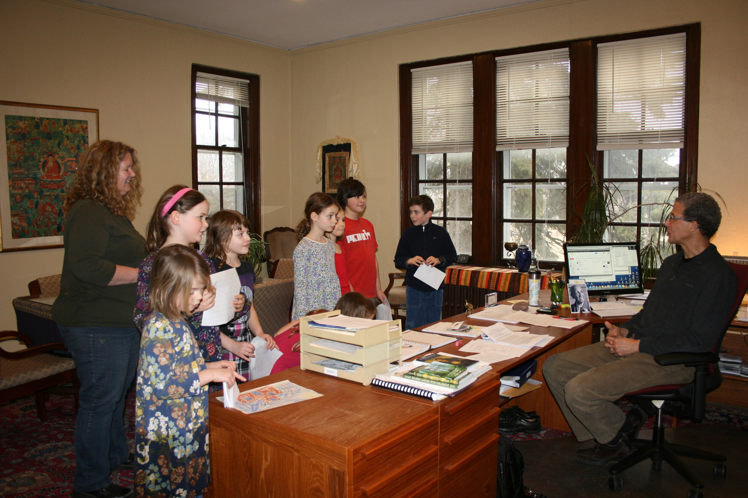 Tim Boyd, president of the Theosophical Society in America, meets with some Prairie School students to listen to their plans for building a bird sanctuary on the grounds.