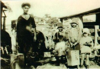 Johnstone family milking 1930