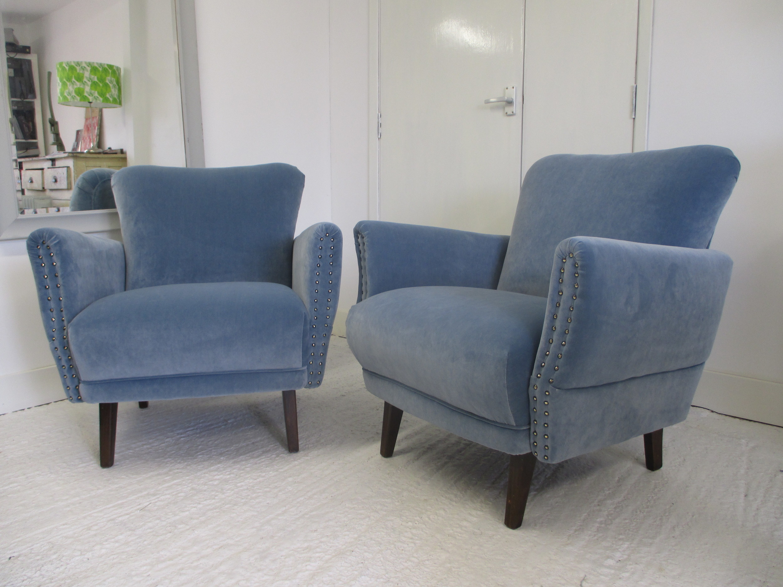 This August I have had the pleasure of recovering these two armchairs. They are from the 1960s and were bought on ebay and shipped over from Germany. Now they are on their way to the owners seaside retreat in Hastings.   The fabric is a blue velvet from Linwood.