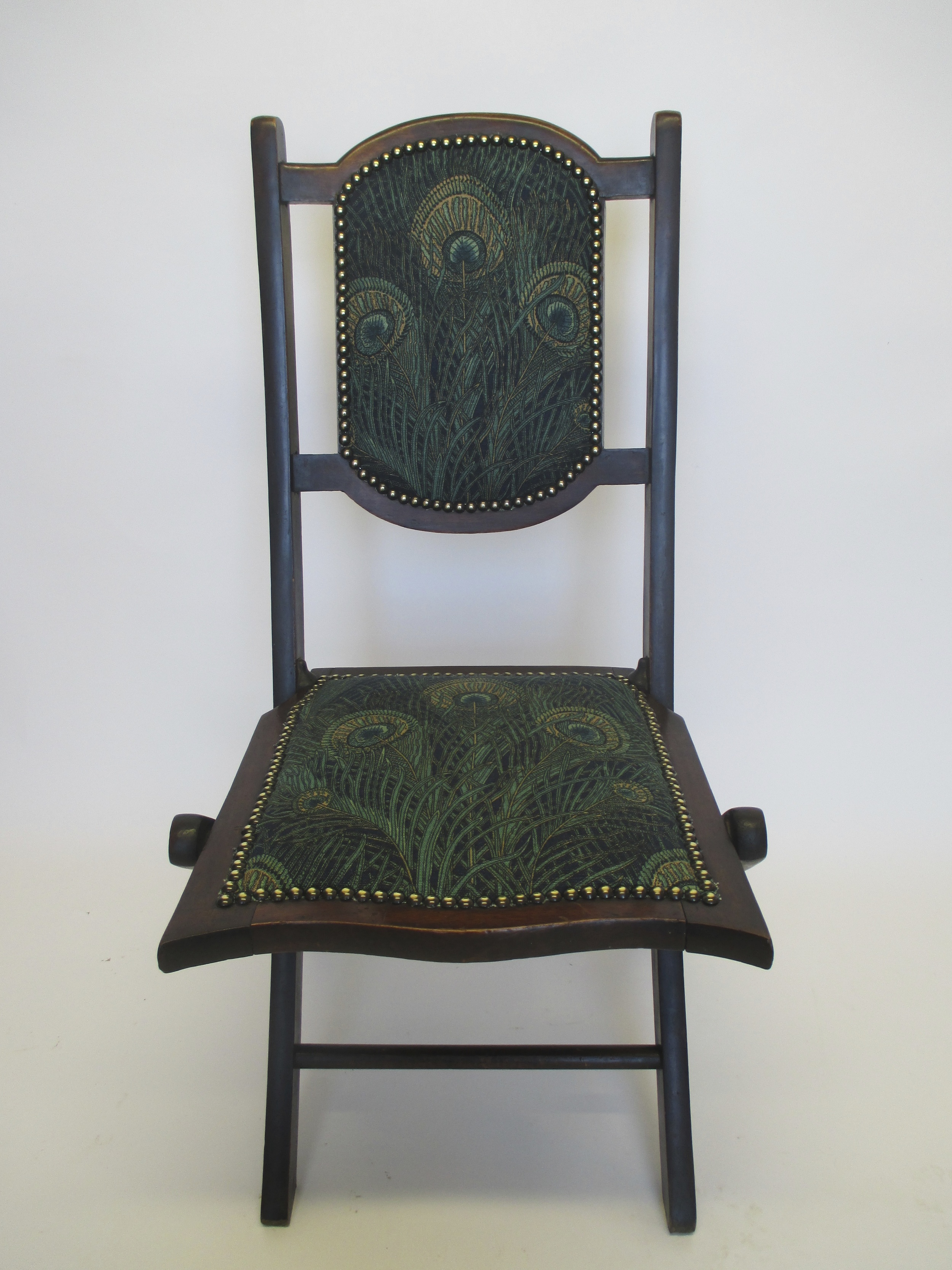 I love Liberty's and its a joy to cover a 19th Century folding chair in their fabric. It was designed in 1887 andis calledMermaidHera Linen Union and n amed after the Greek goddess, whose sacred animal was the peacock.