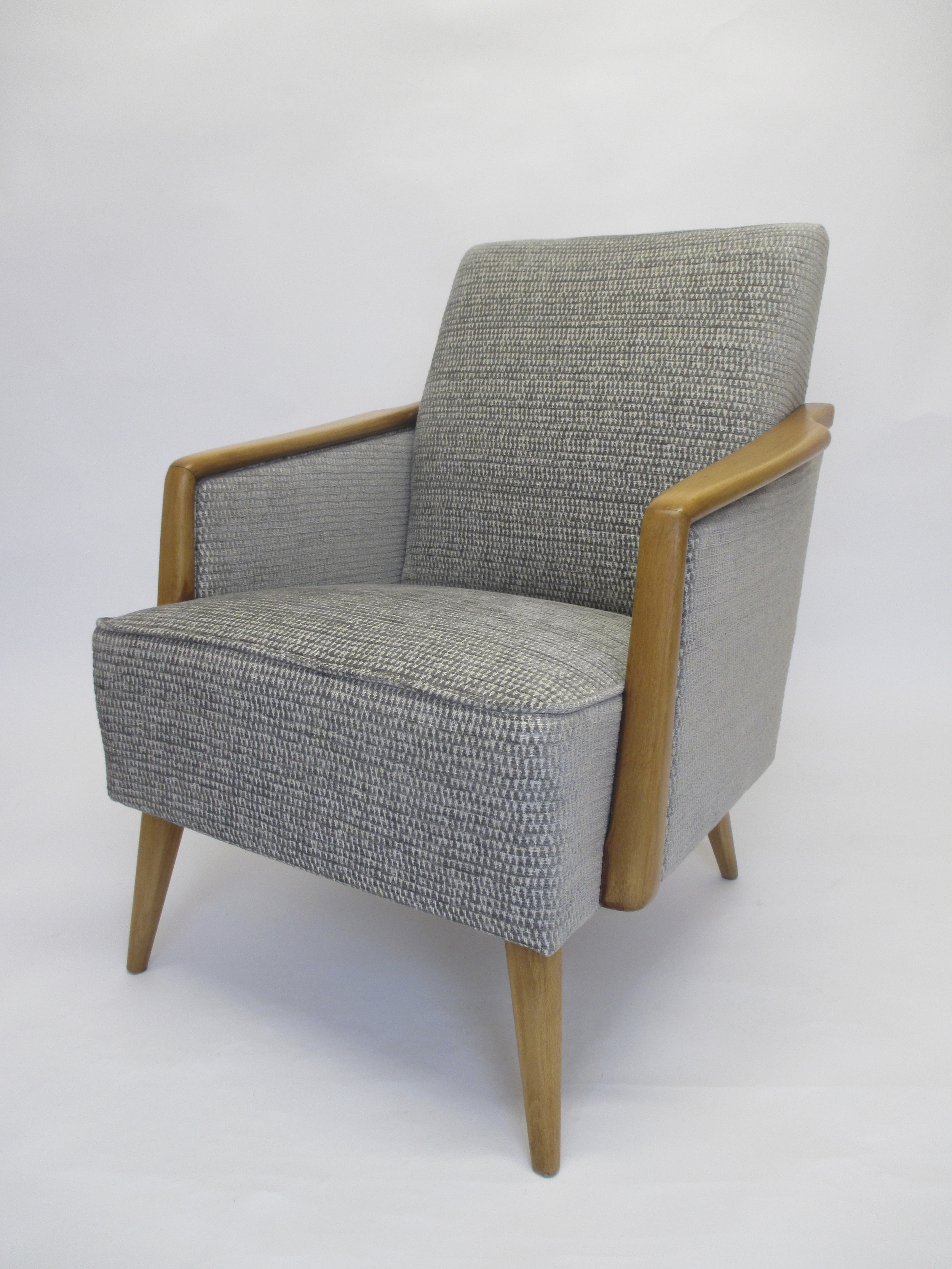 This chair was purchased from the 'Peanut Vendor', a London based shop who specialise in mid century furniture. It has been covered in a silvery grey Sanderson fabric that gives it a fresh clean look, enhancing the shape and line of the show wood.