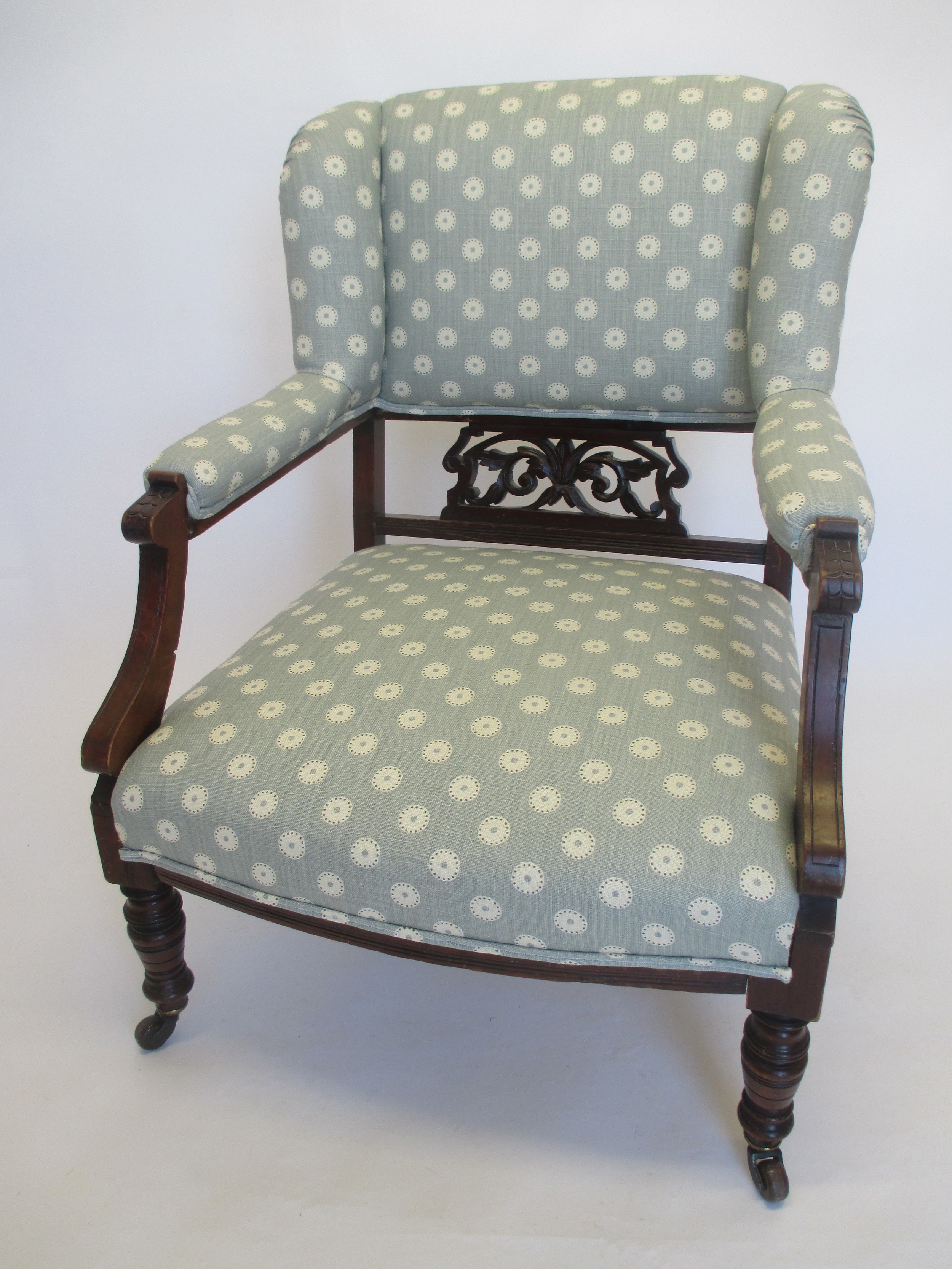 This chair is covered in 'Pretty Maids' by Vanessa Arbuthnott. The fabric is light and fresh and lifts the chair letting the detailing in the wood stand out.