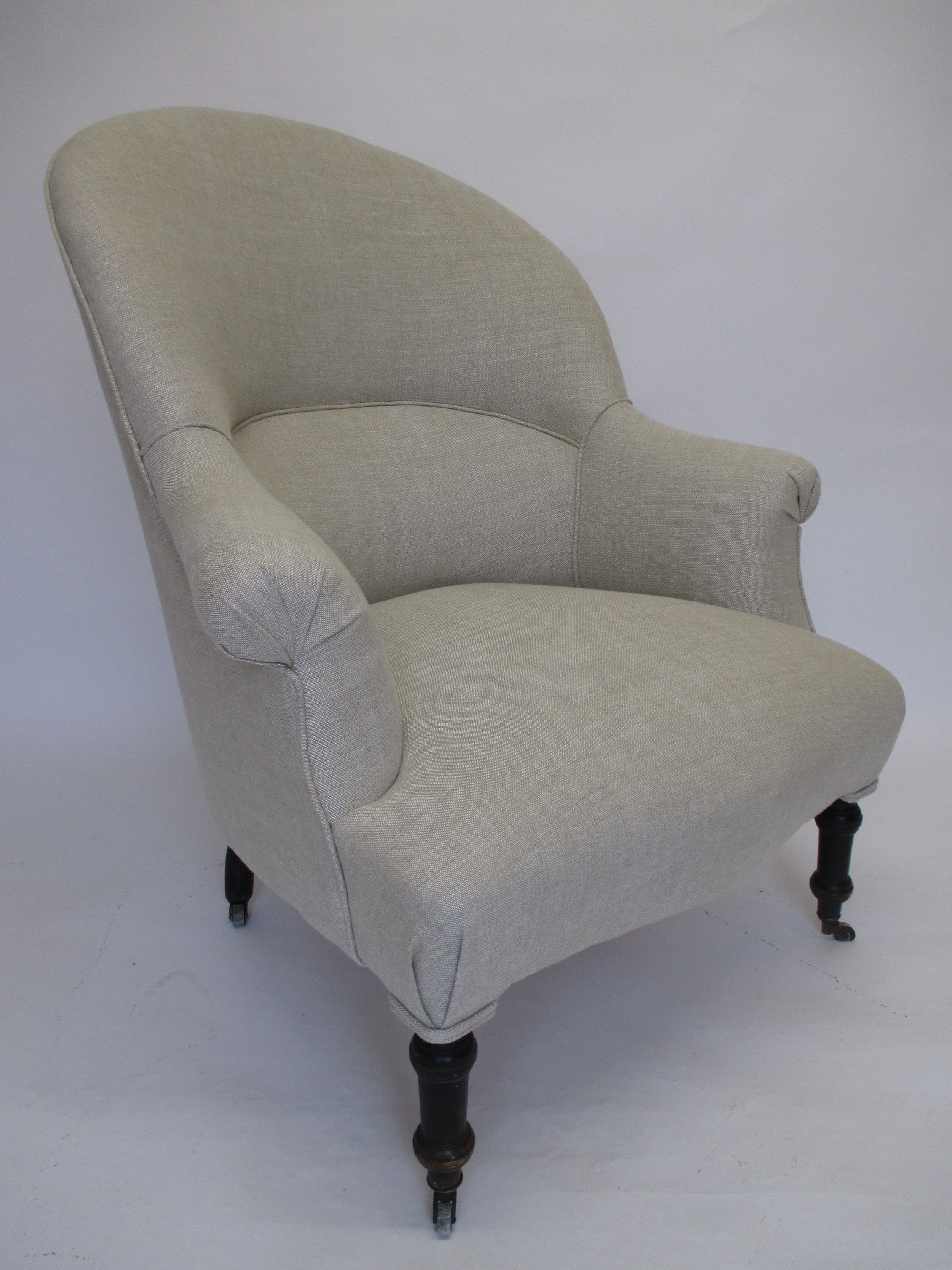 This french chair with a tapered back has been covered in a simple linen fabric from Linwood, a classic combination.