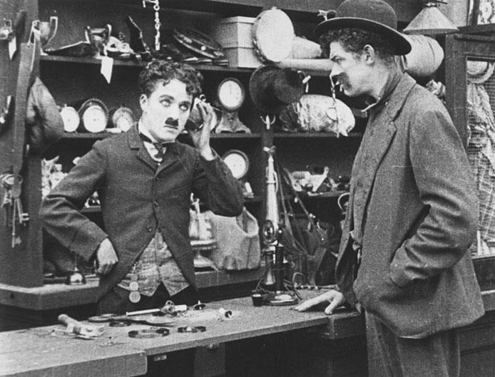 Charlie Chaplin in his pawnbroker's shop