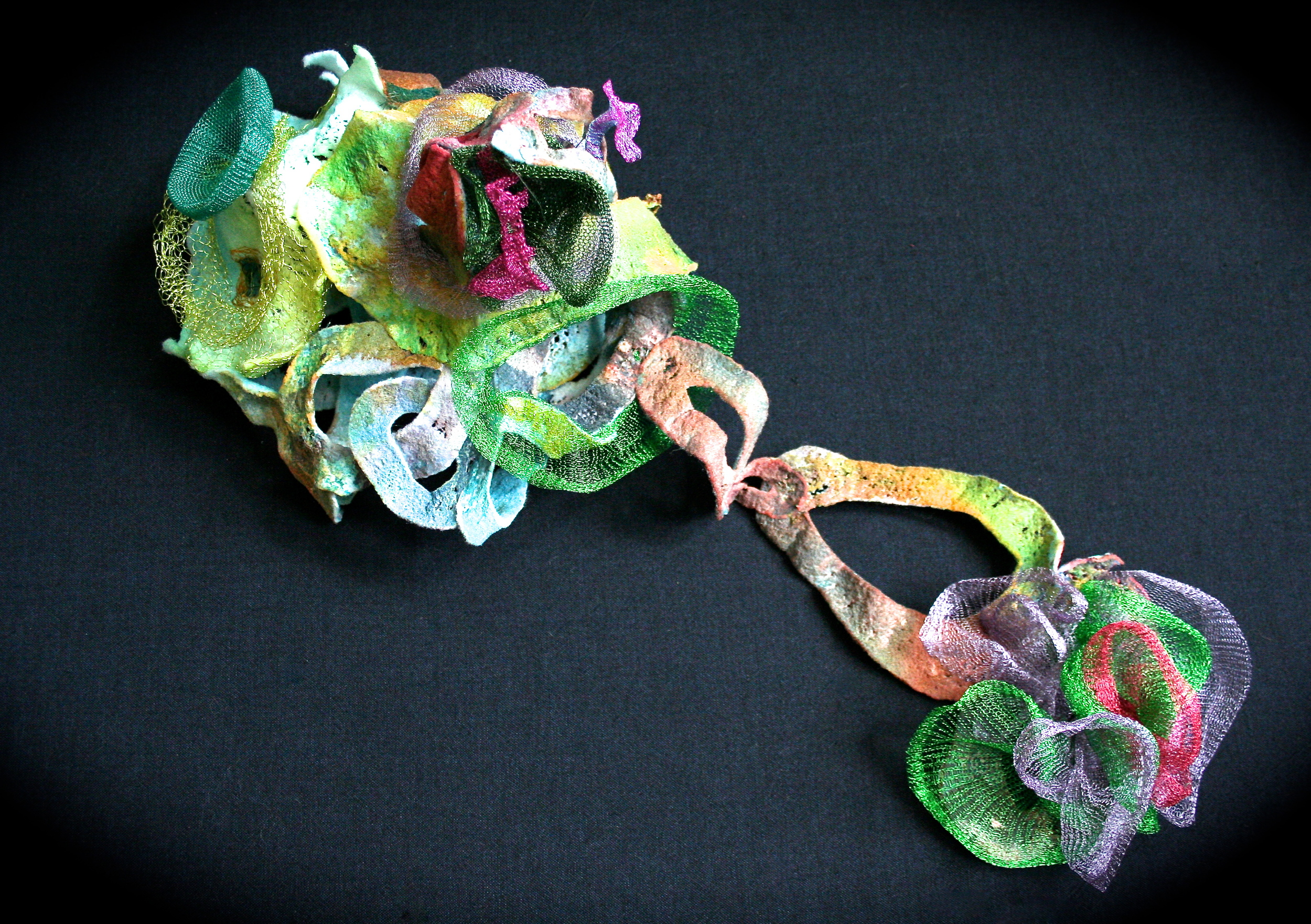 Dyed, melted Fosshape with manipulated wire knit