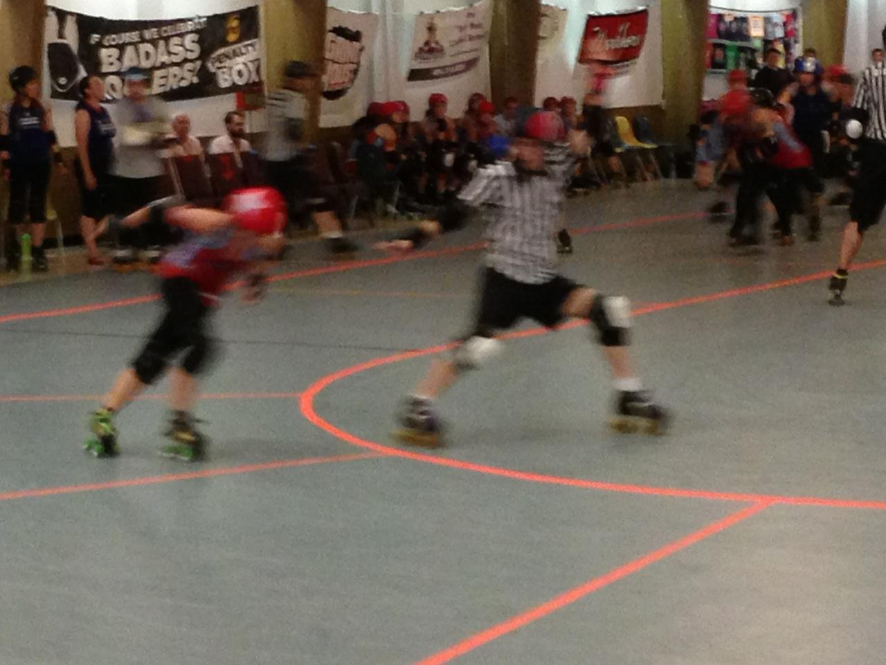 Jammer and ref roller derby