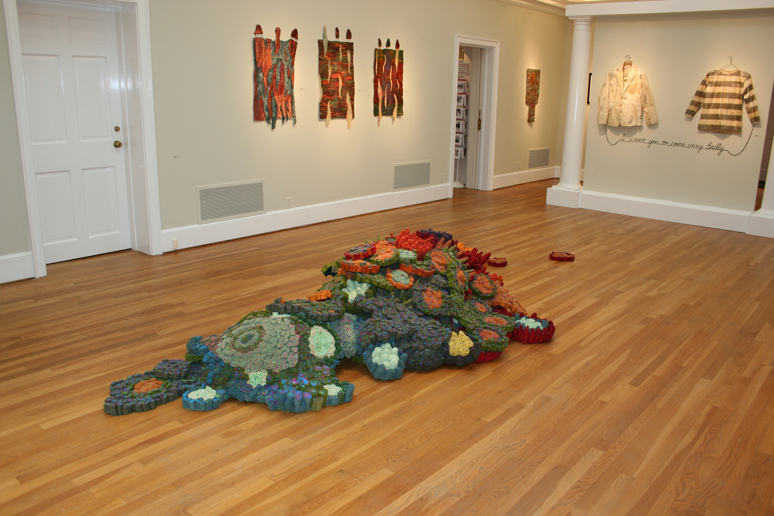 (in)CONSEQUENTIAL by Leisa Rich will soon get hidden in a variety of locations to become one with the earth, or to be discovered and adopted by its finders....here is the view at Swan Coach House gallery