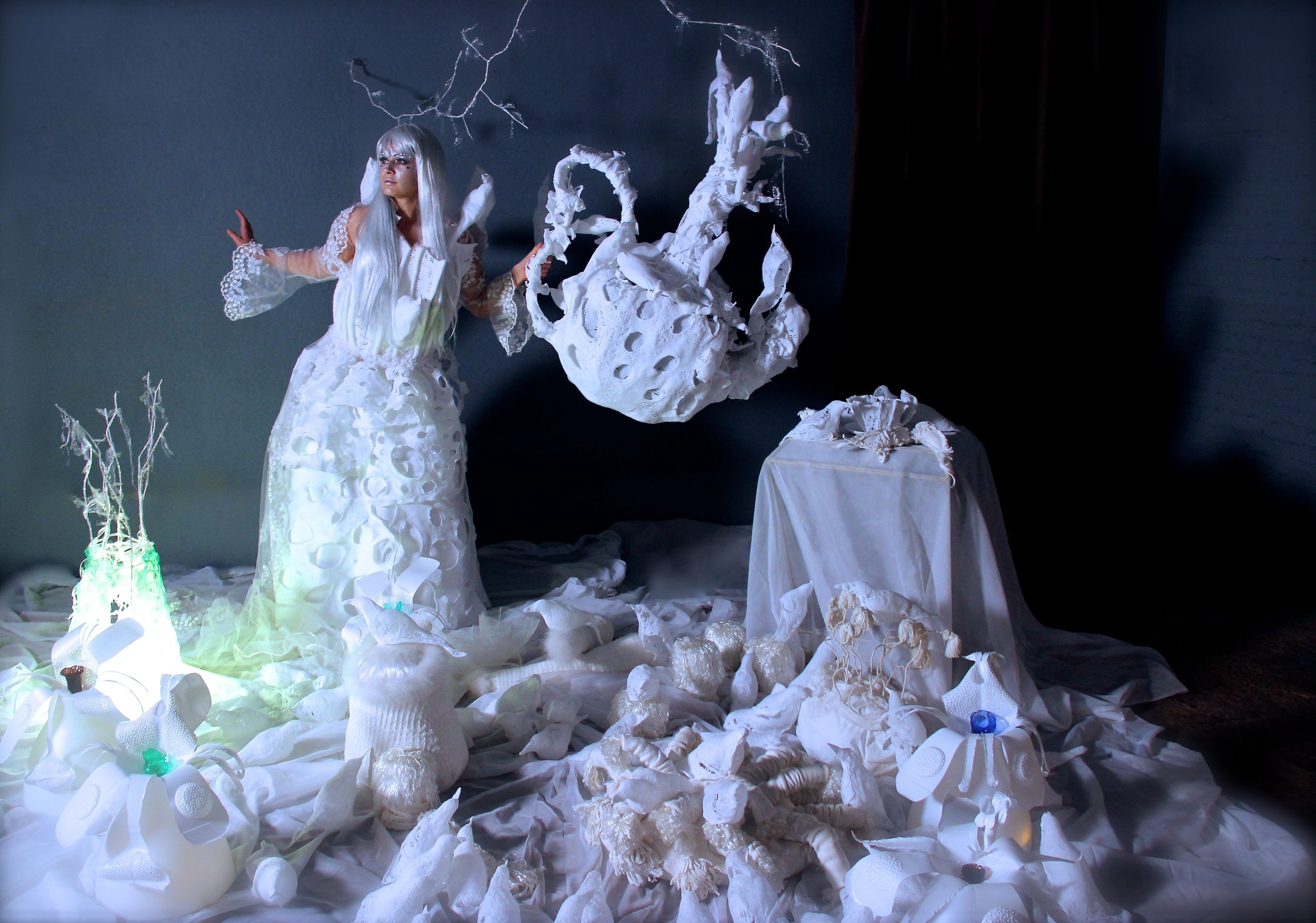Birds of a Feather dress and Falling From the Nest teapot installation by Leisa Rich