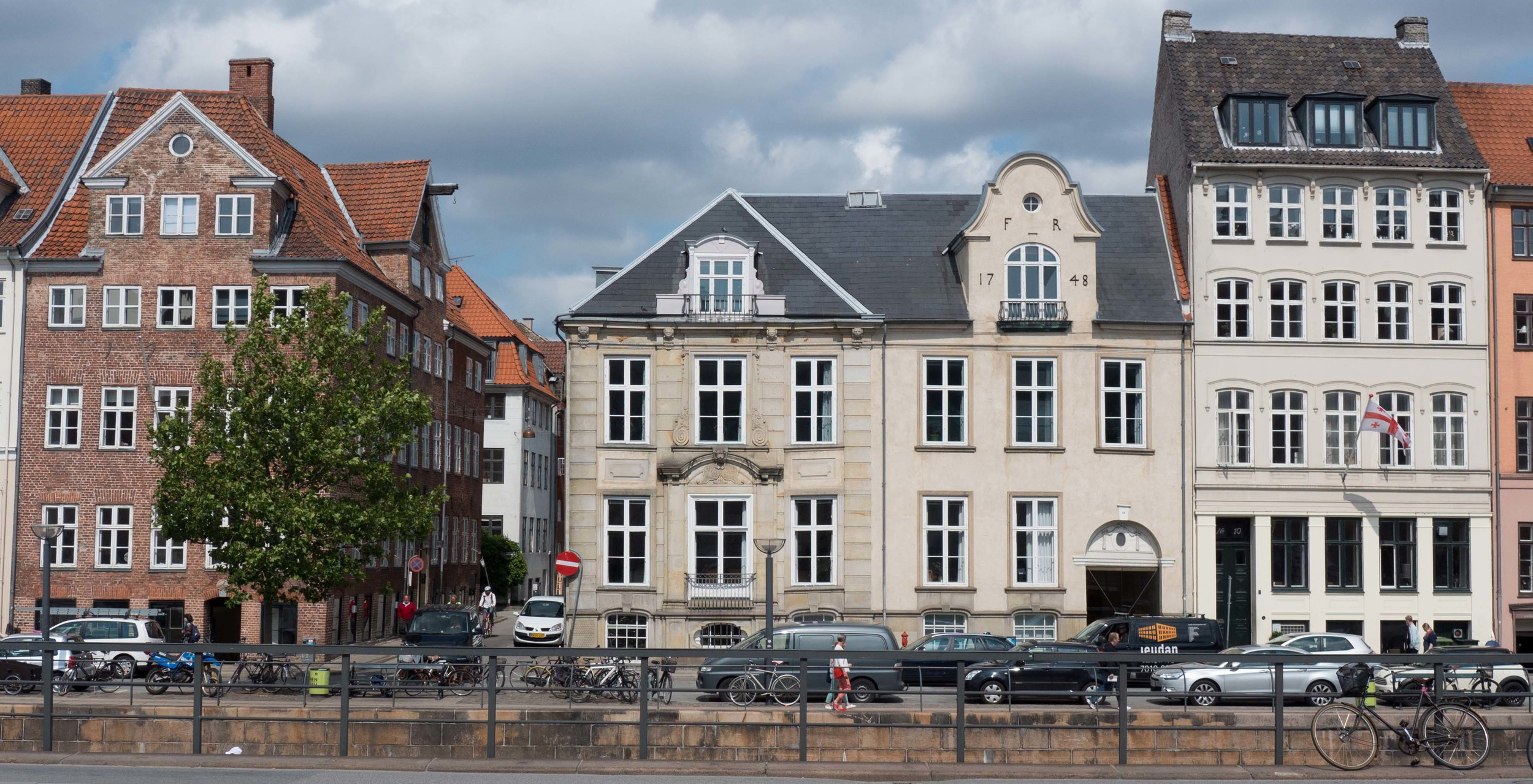 Nybrogade, Copenhagen. The brick house is typical of buildings constructed after the fire of 1728. The mansion in the centre was built in 1732 for J Ziegler the Court confectioner and the adjoining buildings to the right, one dated 1748, are typical of the grey and cream stone colours that were common in Copenhagen through the second half of the 18th and the early 19th centuries.