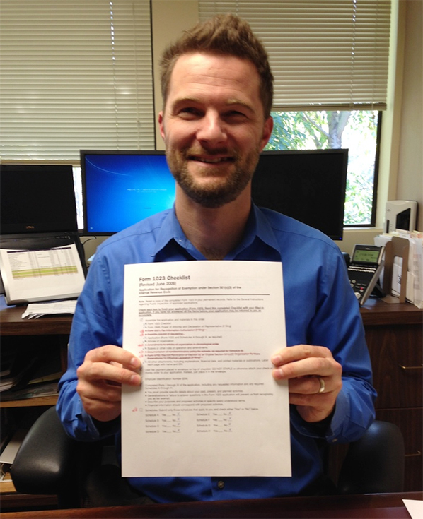 Dashiell Thompson with Eckhoff Accountancy holding our completed file, ready to be mailed!