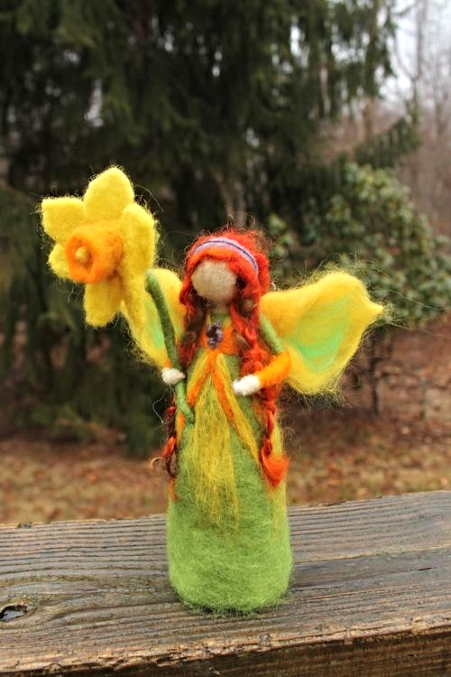 One of Nicole's needle-felted fairies. Simply explained: needle felting is a type of fiber art where you poke wool with an incredibly sharp needle in order to bind together the fiber to create unique sculptures. Sounds totally random, but it's pretty fun and relaxing! (N. Totino-Clark,  ColeMama Creations )