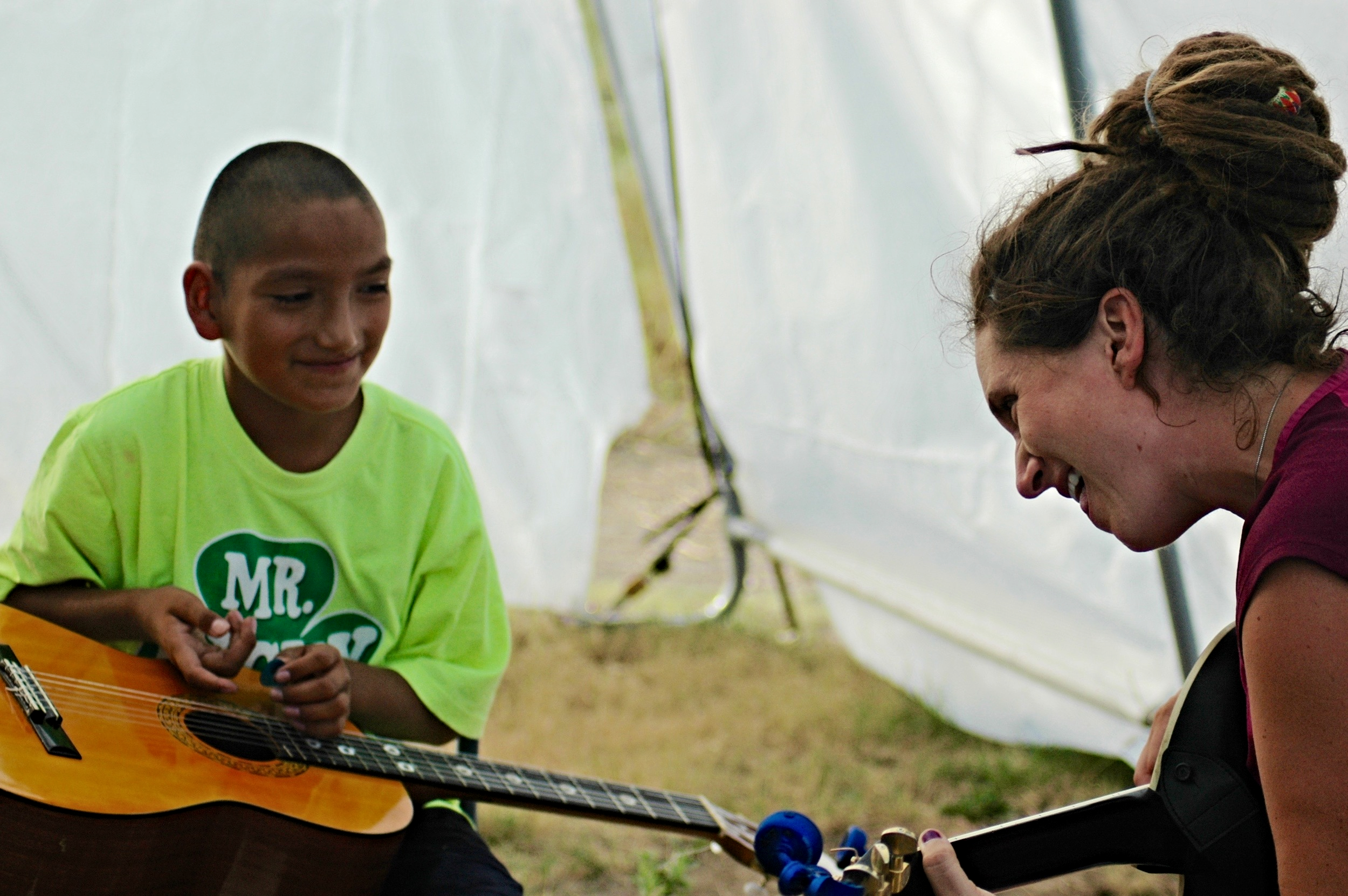 When Kristen is not traveling and performing, she spends her time teaching music camp on the Cheyenne River Reservation with Simply Smiles.